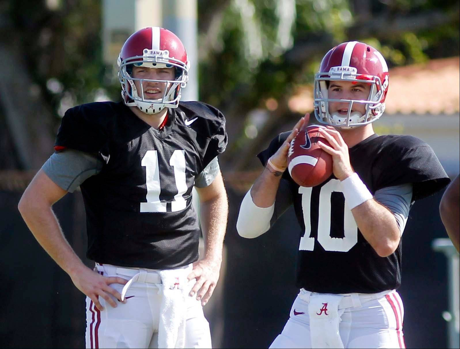 Alabama quarterbacks AJ McCarron (10) and Alec Morris (11) workout Thursday during practice at Barry University in Miami Shores, Fla.