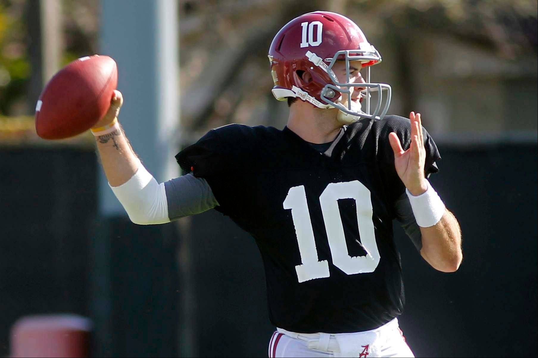 Alabama quarterback AJ McCarron (10) throws Thursday during practice at Barry University in Miami Shores, Fla.