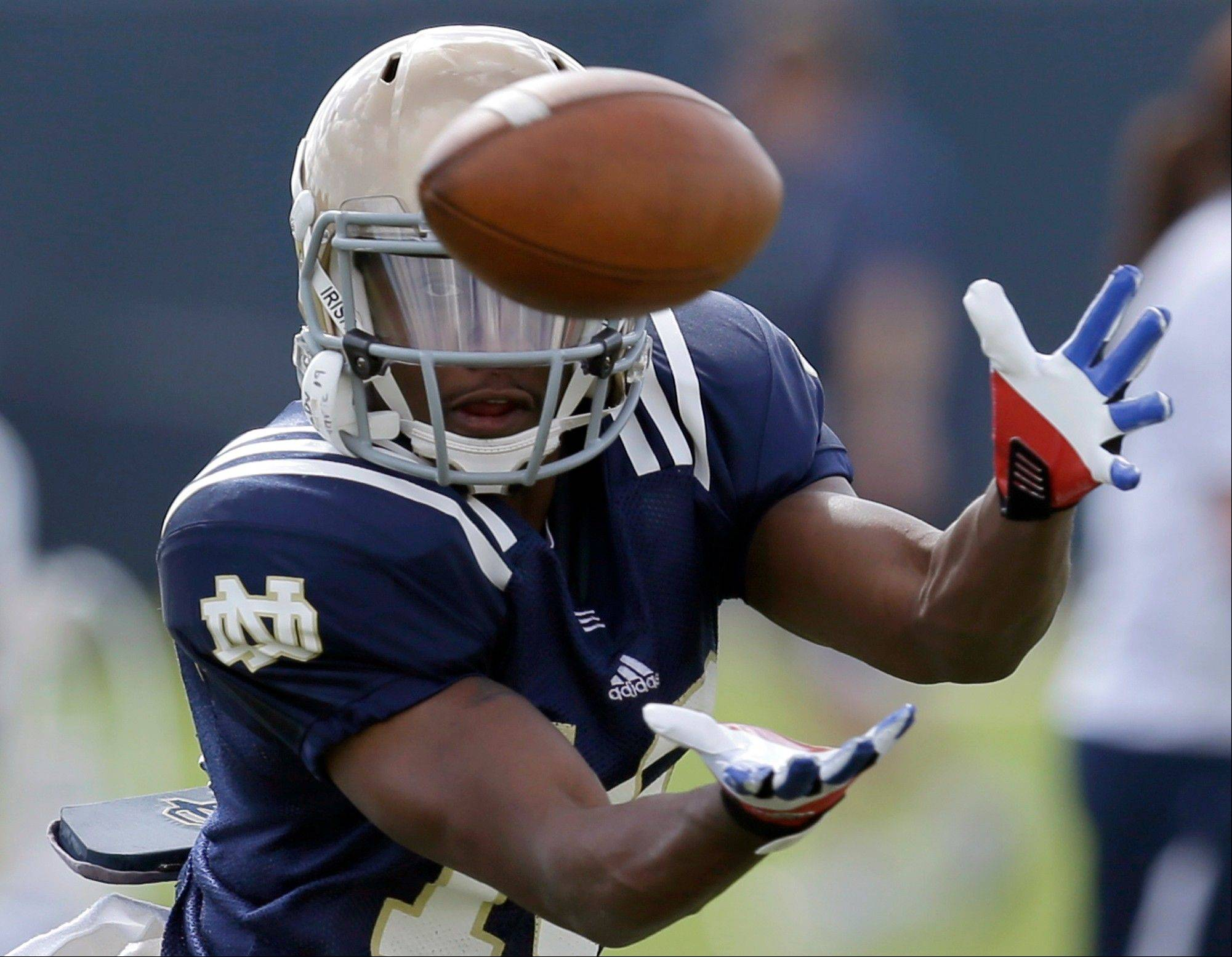 Notre Dame wide receiver Davonte' Neal catches a pass Thursday during practice at the Miami Dolphins' training facility in Davie, Fla.