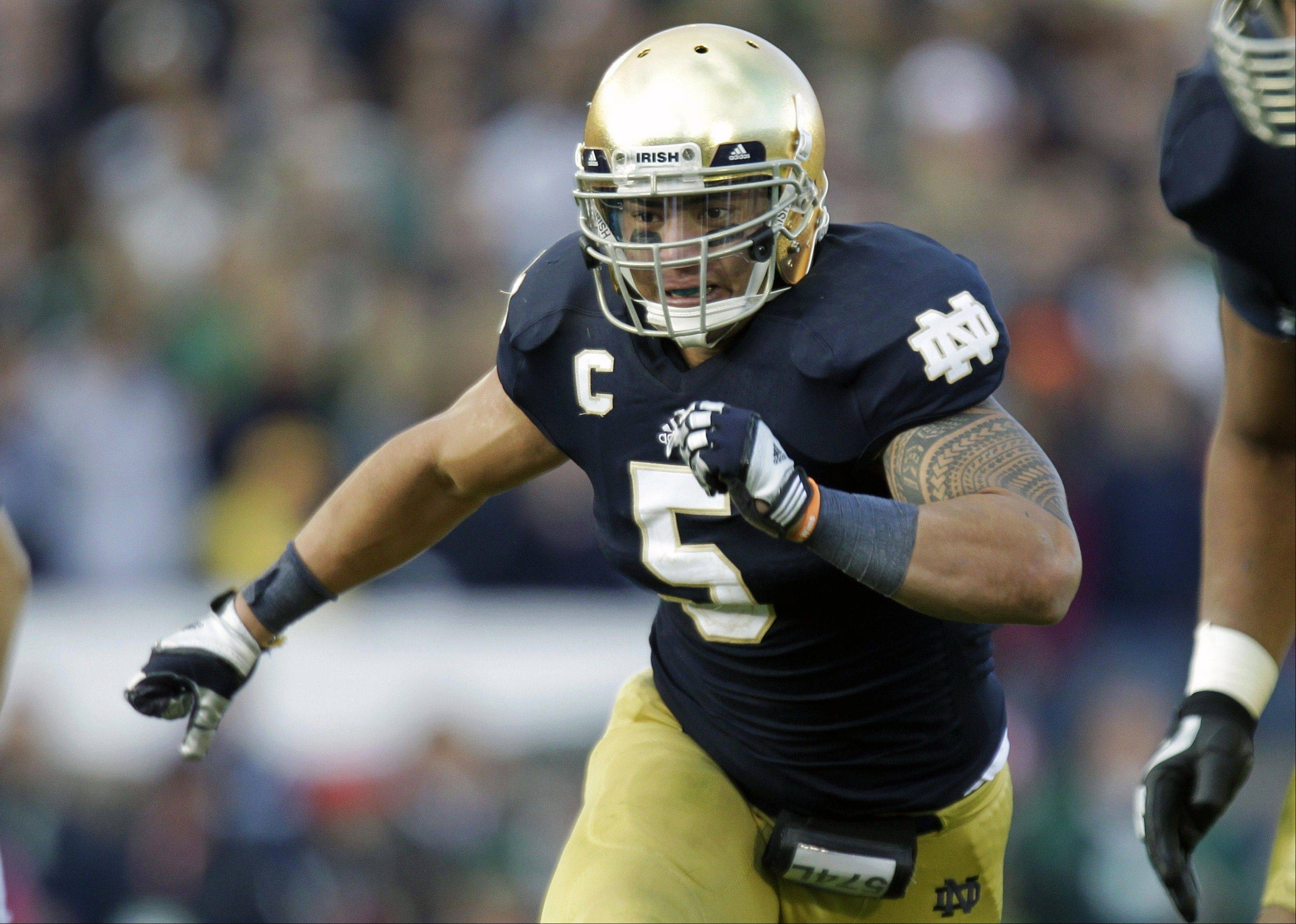 Notre Dame linebacker Manti Te'o plays against BYU earlier this eason. Alabama's Barrett Jones and Notre Dame's Te'o are All-Americans and national award winners. They're also fine students who emphasize faith and postponed big money from the NFL to stay in school.