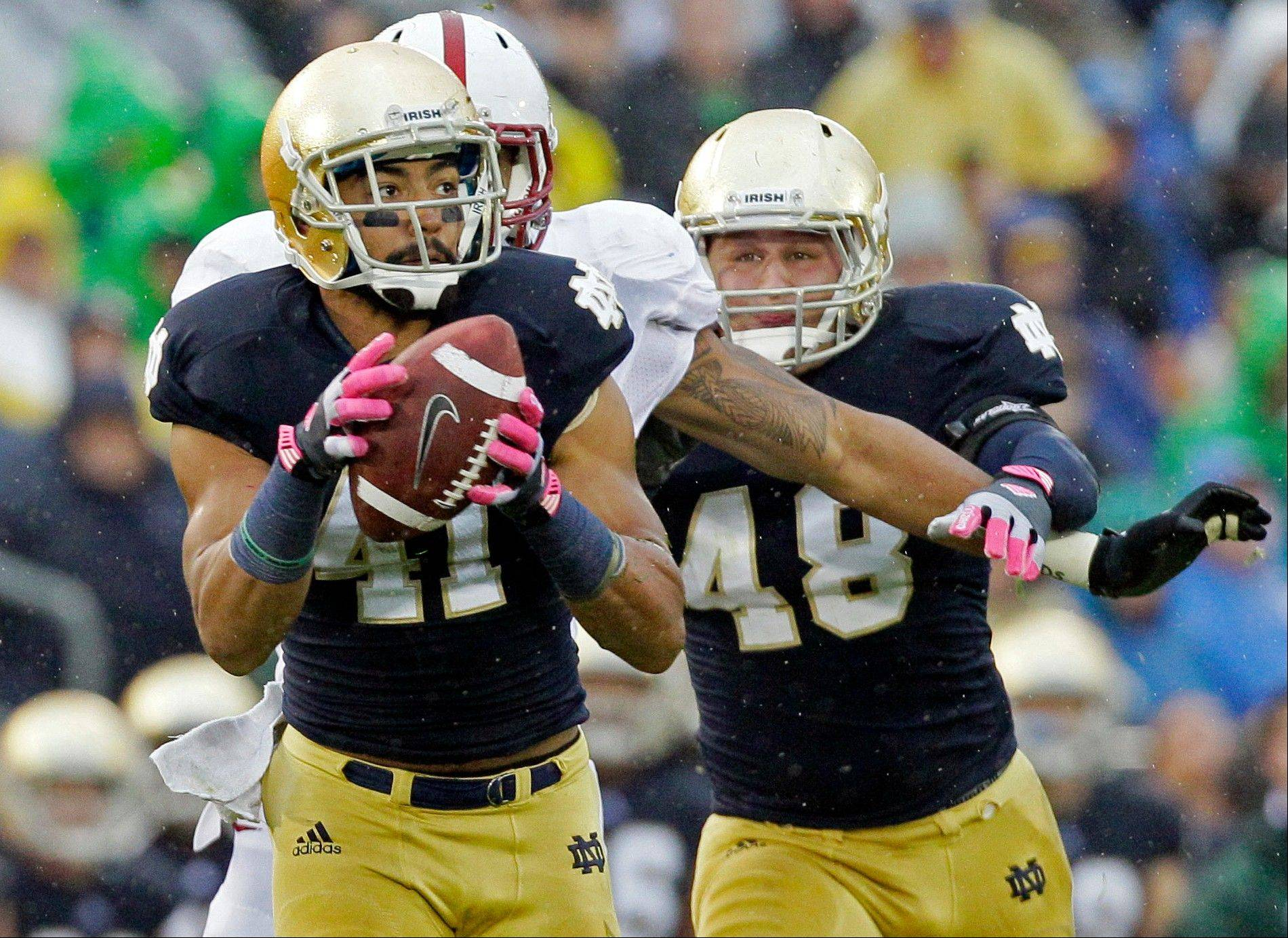 Notre Dame safety Matthias Farley (41) intercepts a pass past Stanford tight end Levine Toliolo. Farley was a soccer player before transitioning to football, first as a wide receiver and now a starting safety for No. 1 Notre Dame.