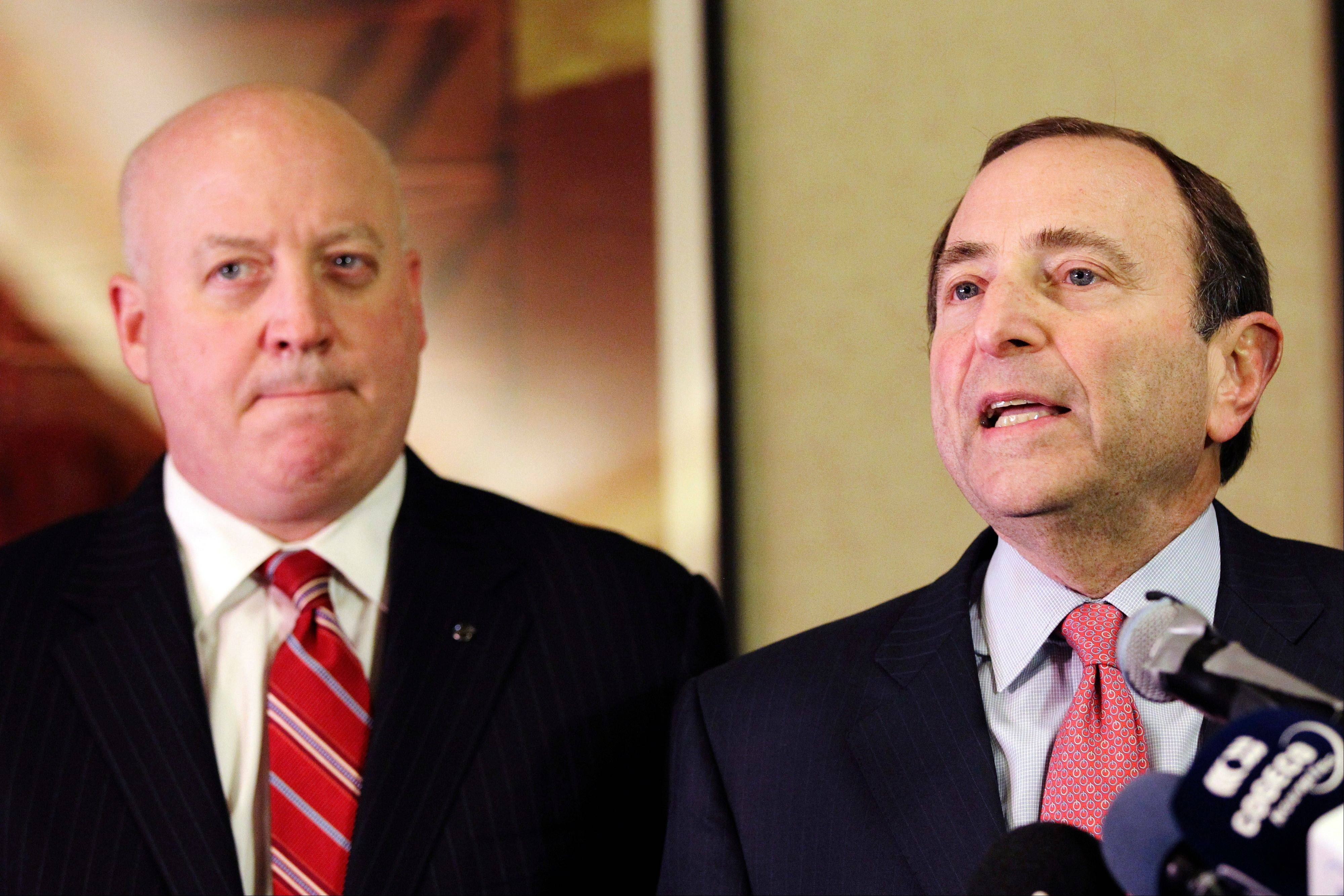 FILE -- In this Dec. 6, 2012, file photo, NHL Commissioner Gary Bettman, right, and deputy commissioner Bill Daly speak to reporters in New York. Bettman has told the players union that a deal must be in place by Jan. 11 in order for a 48-game season to be played beginning eight days later.