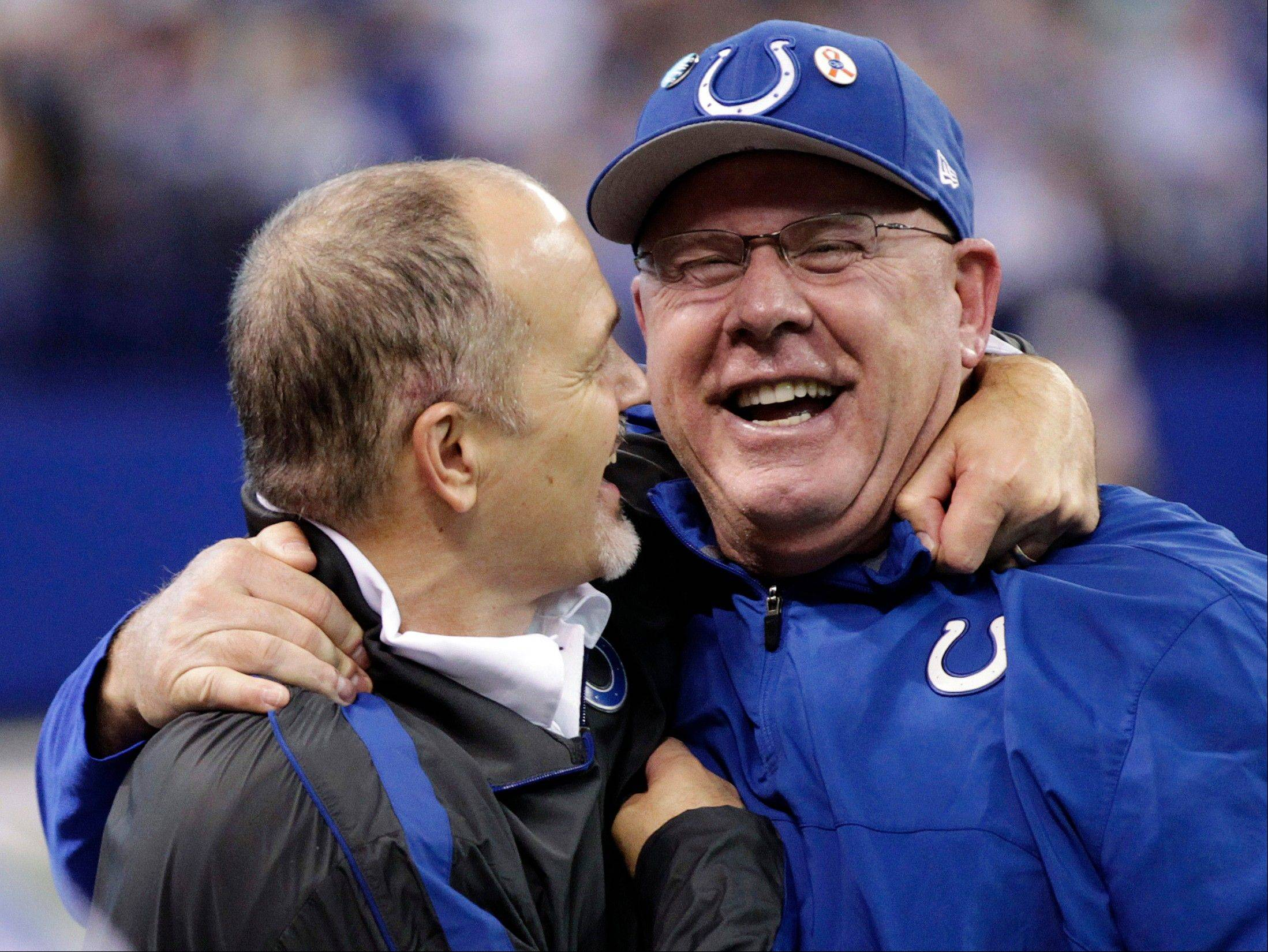 Indianapolis Colts head coach Chuck Pagano, left, celebrates with offensive coordinator Bruce Arians after their 28-16 win over the Houston Texans on Dec. 30. The Bears reportedly have asked permission to interview Arians for their head coaching position.