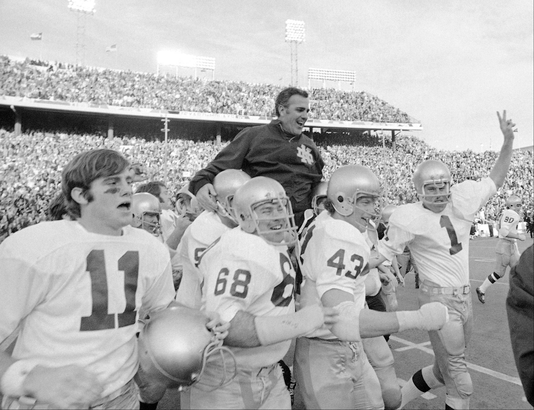 Notre Dame coach Ara Parseghian is carried off the field by his victorious players after the Irish beat Texas 24-11 in the Cotton Bowl in Dallas. At a time when college football was generally considered the domain of eastern blue bloods, Notre Dame and Alabama were upstart teams that gave blue collar fans a chance to tweak the elite. About 90 years later, the Fighting Irish and Crimson Tide are the elite -- two of college football's signature programs, set to play a national championship next Monday in Miami that could break records for television viewership.