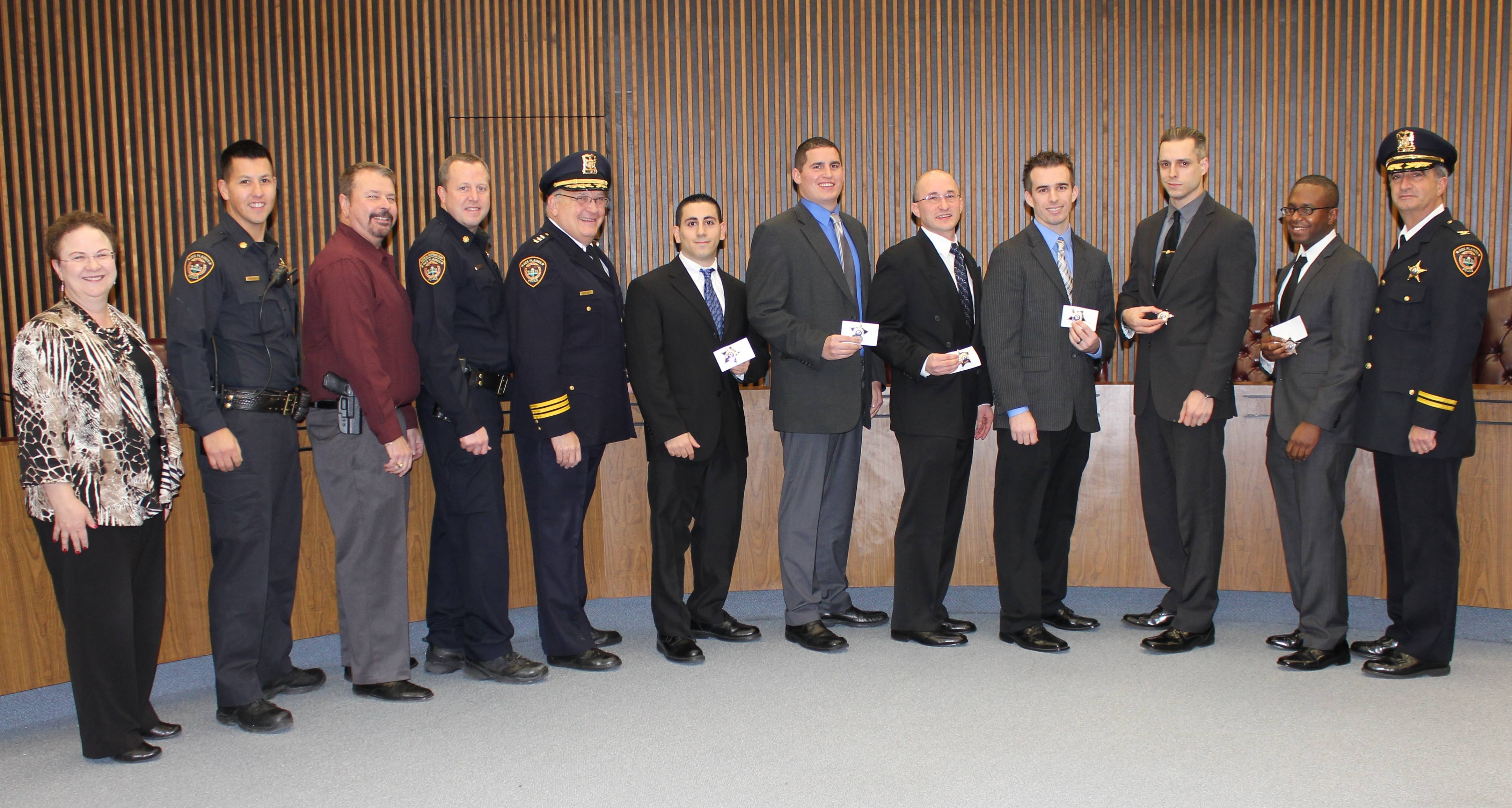 (pictured left to right) City Clerk Gloria Ludwig, Des Plaines Police Commander Louis Wittmer, Commander Randy Akin, Commander Paul Burger, Police Chief Bill Kushner, Police Patrol Officer Jack Azar, Police Patrol Officer Thomas Doig, Police Patrol Officer Carl Faust, Police Patrol Officer Jimmy Armstrong, Police Patrol Officer Curtis Miller, Police Patrol Officer William Cozzens, and Deputy Chief Nick Treantafeles pose for a photograph in the City Council Chambers following the swearing in ceremony.