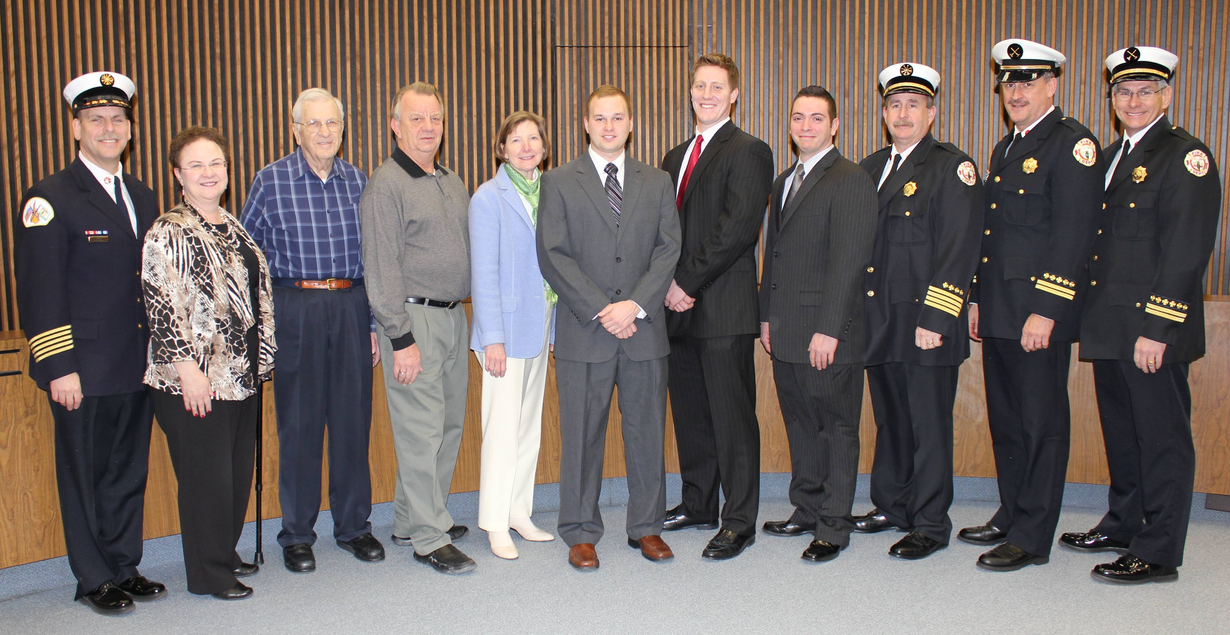 (pictured left to right) Fire Chief Alan Wax, City Clerk Gloria Ludwig, Board of Fire & Police Commissioners Chairman Arthur Lukowicz, Board of Fire & Police Commissioner Michael Albrecht, Board of Fire & Police Commissioner Debra Lester, Firefighter/Paramedic Candidate Patrick Tennant, Firefighter/Paramedic Candidate Daniel Garhan, Firefighter/Paramedic Candidate Edward Wilson, Deputy Fire Chief Randy Trost, Fire Division Chief of Emergency Medical Services (EMS) Peter Dyer, and Fire Division Chief of Training Forest Reeder pose for a photograph after the swearing in ceremony.