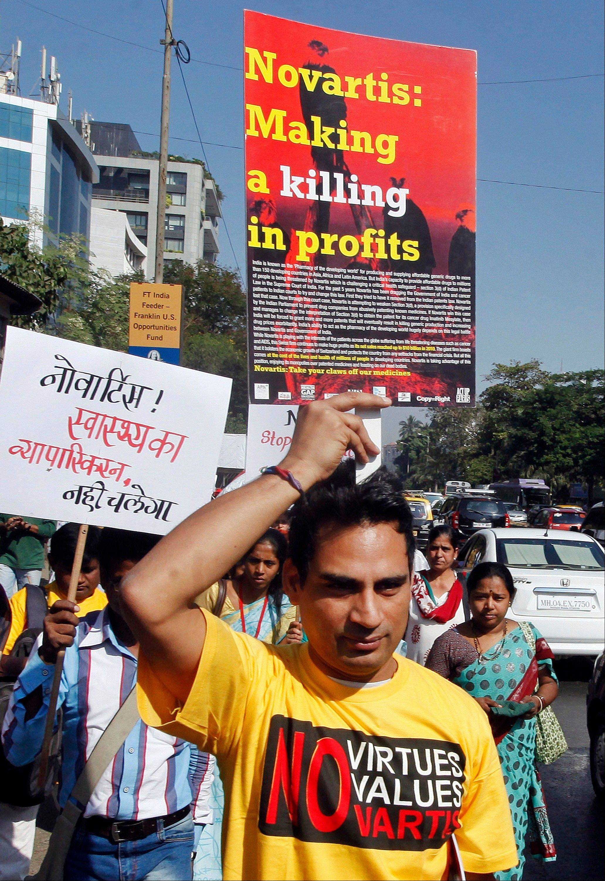 Indian activists protest against Swiss drugmaker Novartis AG outside their office in Mumbai, India. The case � involving Novartis AG�s cancer drug Glivec � pits aid groups that argue India plays a vital role as the pharmacy to the poor against drug companies that insist they need strong patents to make drug development profitable.