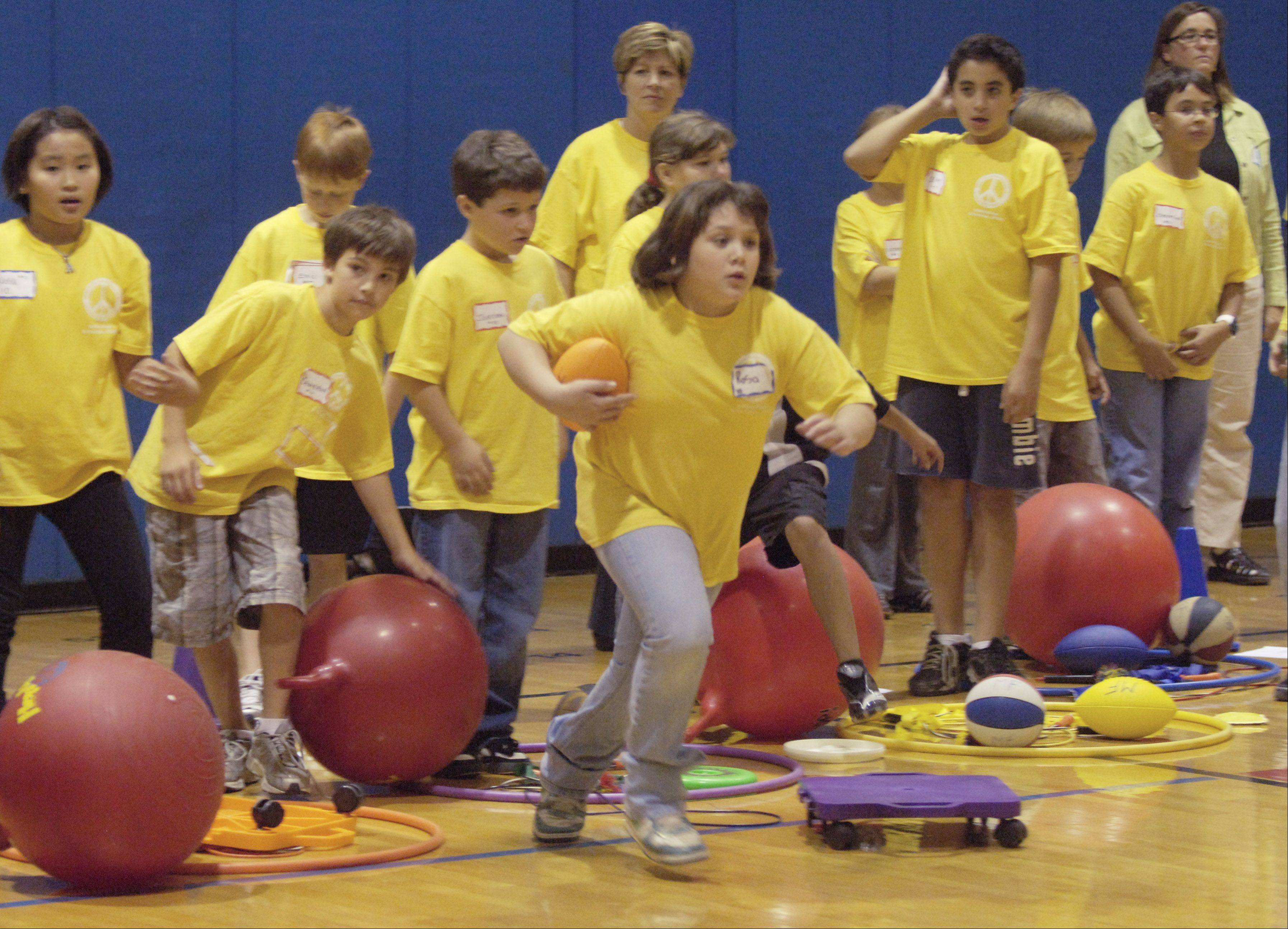 Fifth grade students from Indian Grove and Euclid elementary schools meet for games and fun at River Trails Middle School in Mount Prospect. The event was part of a parent-led effort in the fall of 2010 to dispel bitter feelings left by the controversy over grade-level centers.