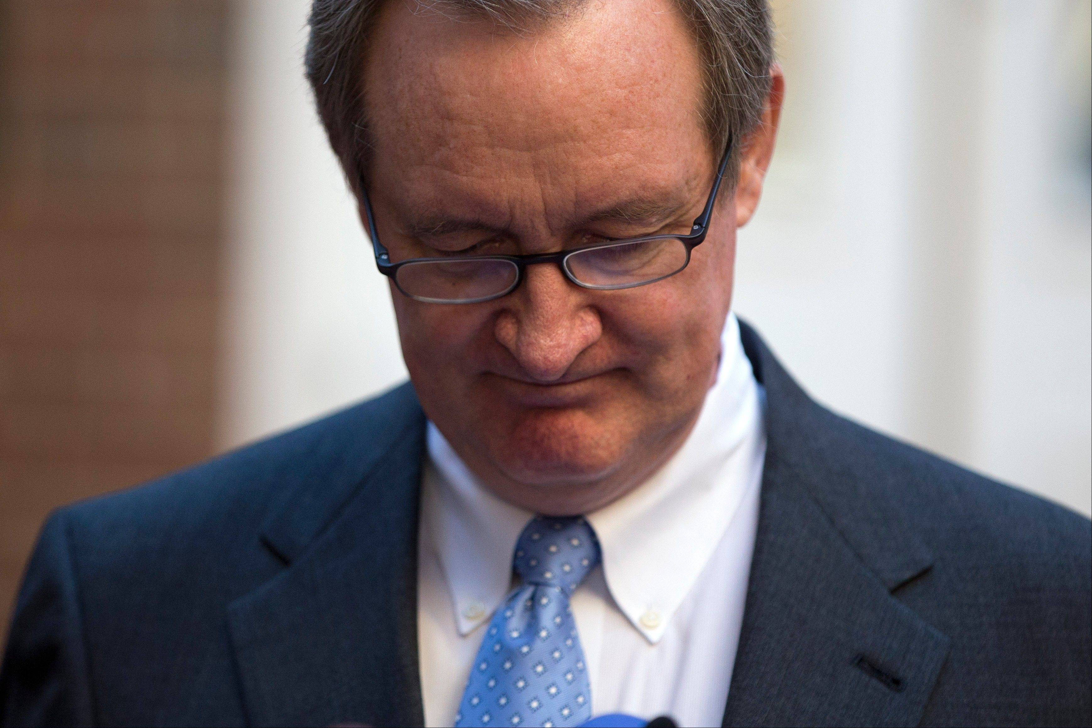 Sen. Michael Crapo, an Idaho Republican,looks down as he reads a statement outside Alexandria General District Court in Alexandria, Va., Friday.
