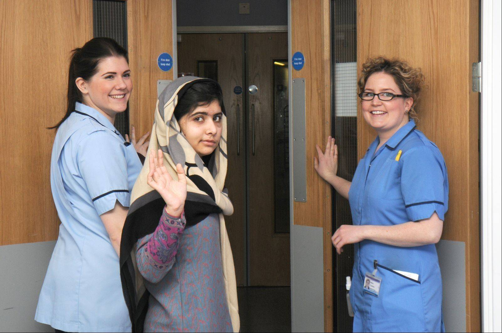This photo, made available by Queen Elizabeth Hospital, Birmingham, England shows Malala Yousufzai saying goodbye as she is discharged from the hospital Friday to continue her rehabilitation at her family's temporary home in the area.
