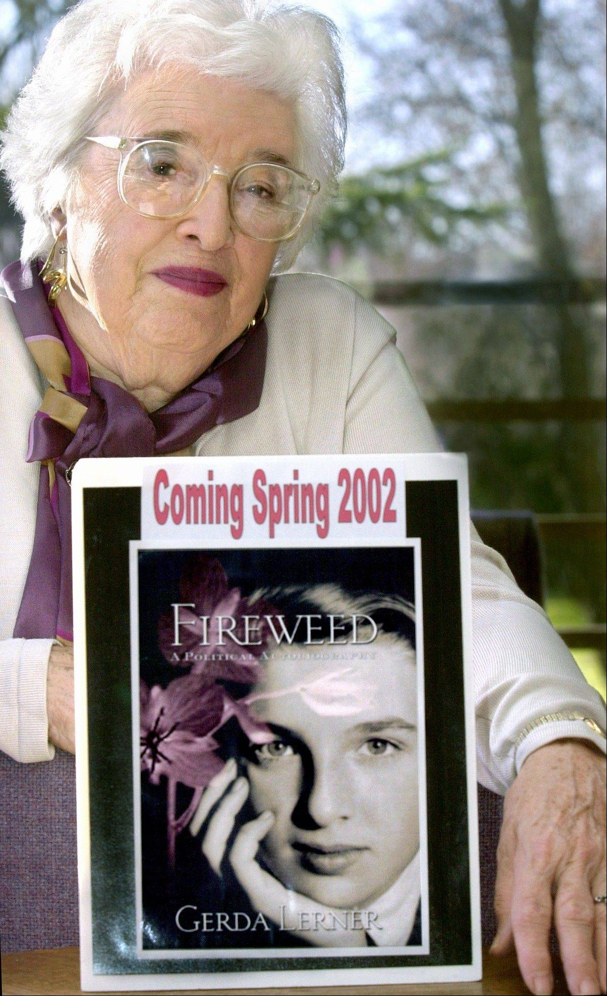 This 2001 photo shows Gerda Lerner, founder of University of Wisconsin-Madison's graduate program in women's history, with an image of her autobiography, Fireweed. Lerner, a founding member of the National Organization for Woman and a pioneer in the field of women's history, has died at an assisted-living facility in Madison. She was 92.