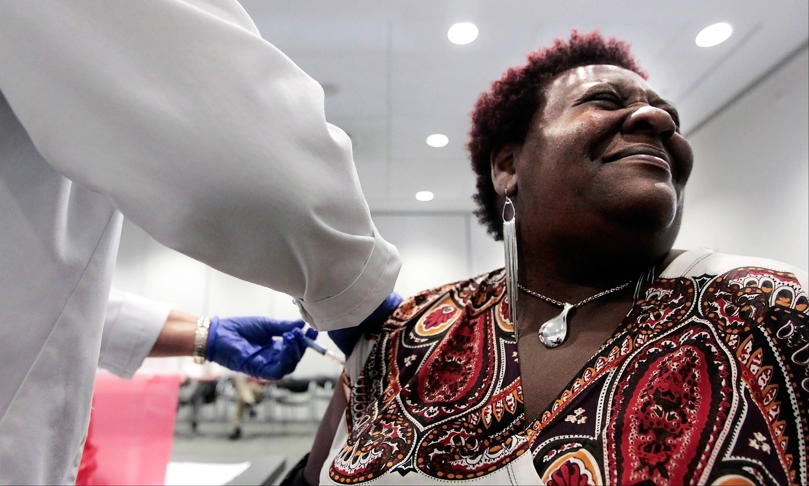Elizabeth Saint Victor winces as she gets a free flu shot from LPN Jean Buck courtesy of Baptist Healthcare in Memphis, Tenn., at the Central Library. Health officials say flu season is off to its earliest start in nearly 10 years _ and it could be a bad one. Officials said Monday, Dec. 3, 2012 that suspected flu cases have jumped in five southern states _ Alabama, Louisiana, Mississippi, Tennessee and Texas. An uptick in flu reports like this usually doesn't occur until after Christmas.