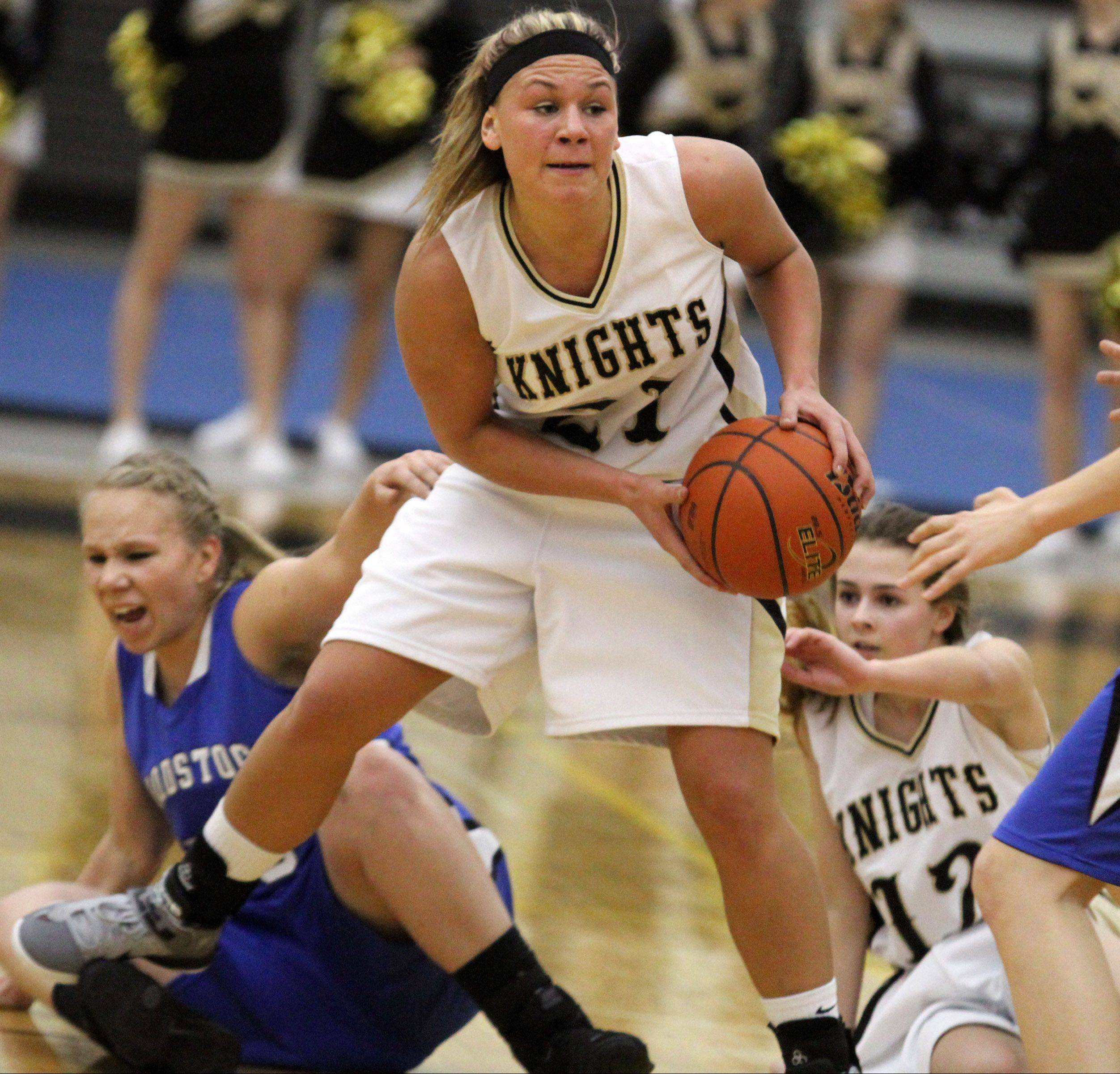 Grayslake North�s Shyanne Ludwick looks to pass after picking up a loose ball against Woodstock in Grayslake on Friday.