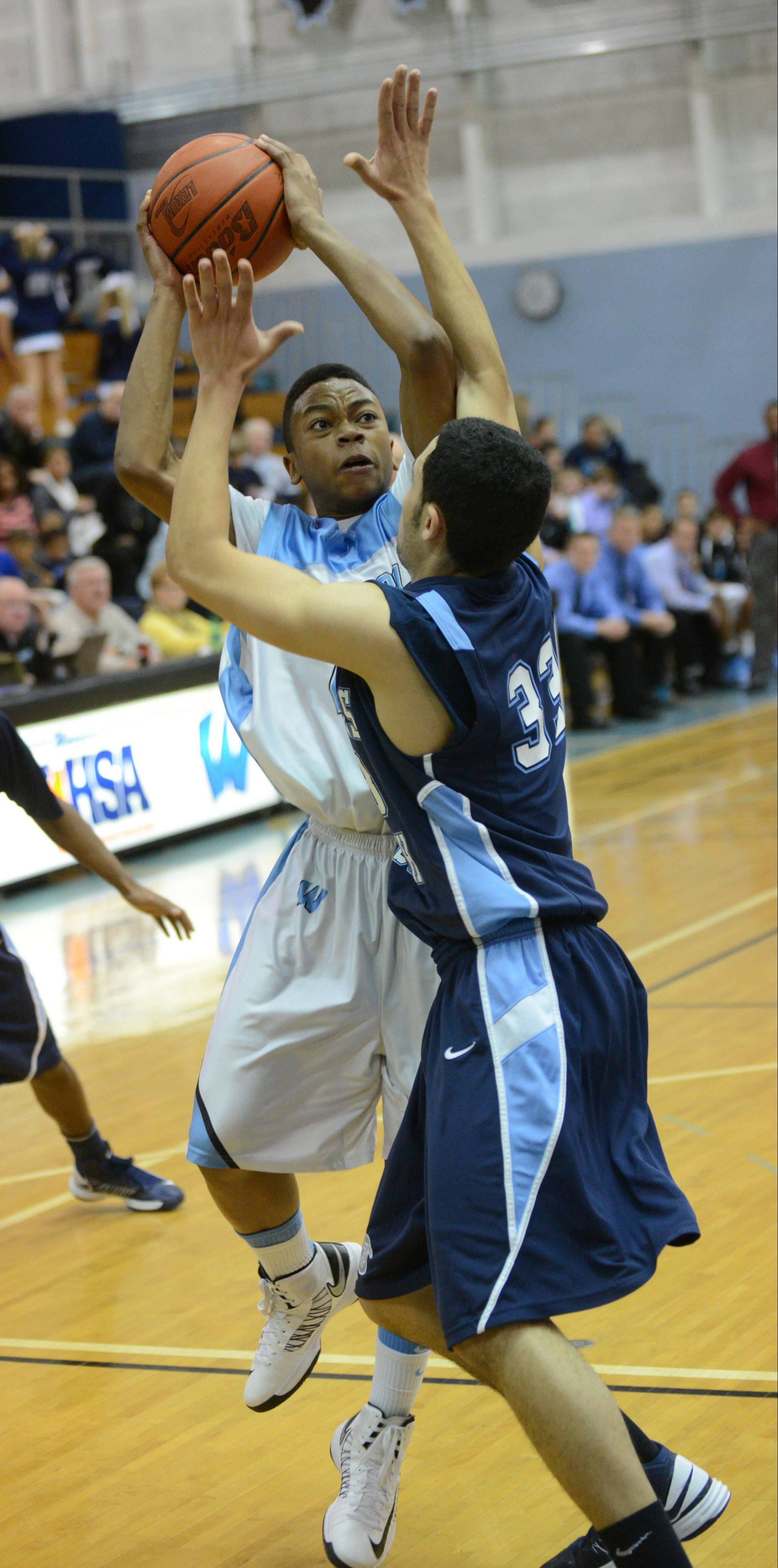 Yashau Trent of Willowbrook puts up a shot over Downers Grove South's Jordan Cannon in West Suburban Gold play Friday in Villa Park.