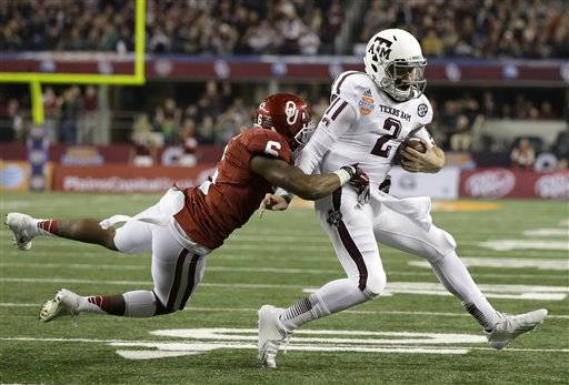 Heisman Trophy winner Johnny Manziel ran for two touchdowns, threw for two more and had a Cotton Bowl-record 516 total yards as 10th-ranked Texas A&M wrapped up its first SEC season with a 41-13 win over No. 12 Oklahoma on Friday night.