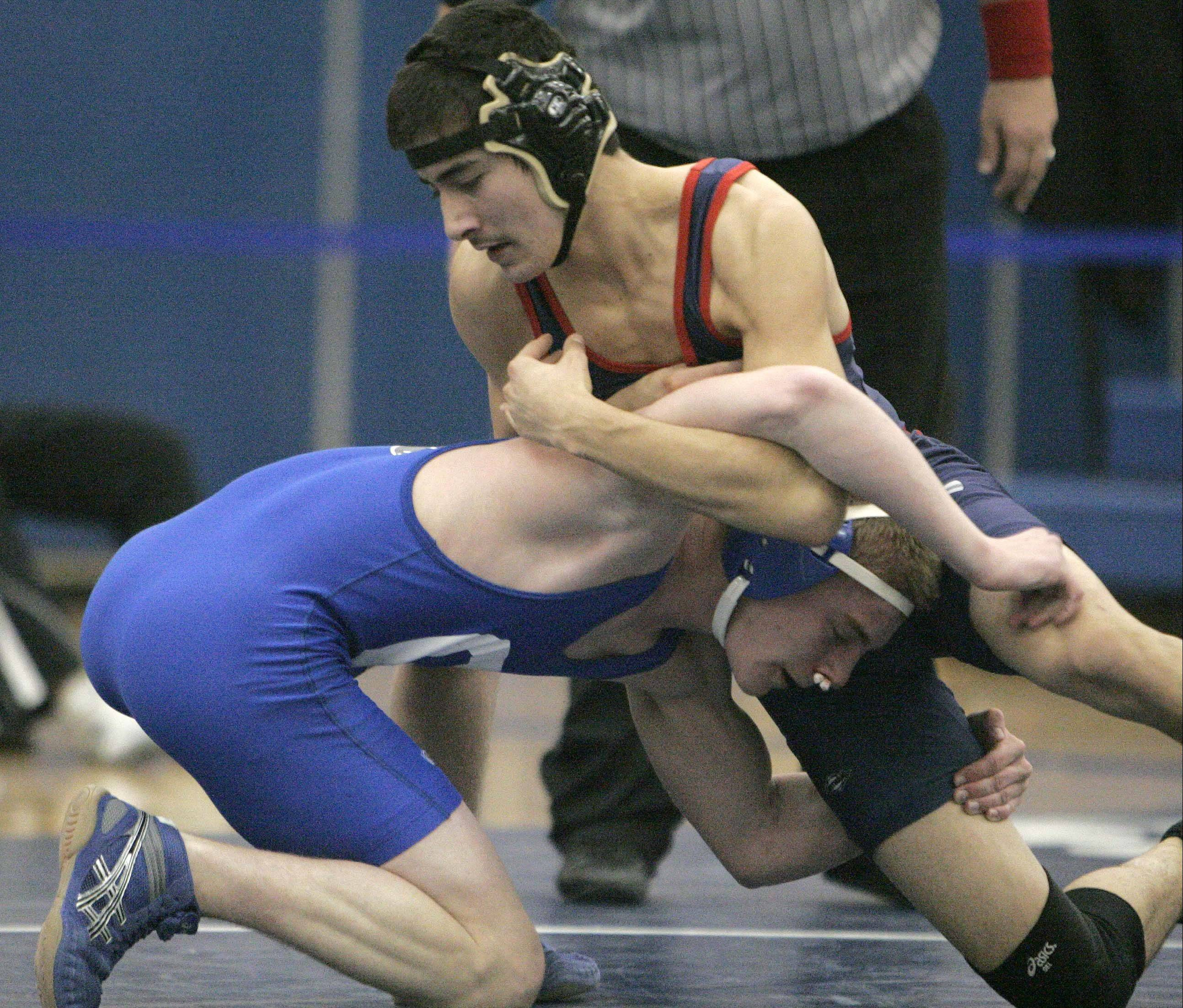 Geneva�s Colin Parsons wrestles South Elgin�s Ricardo De Anda at 132.