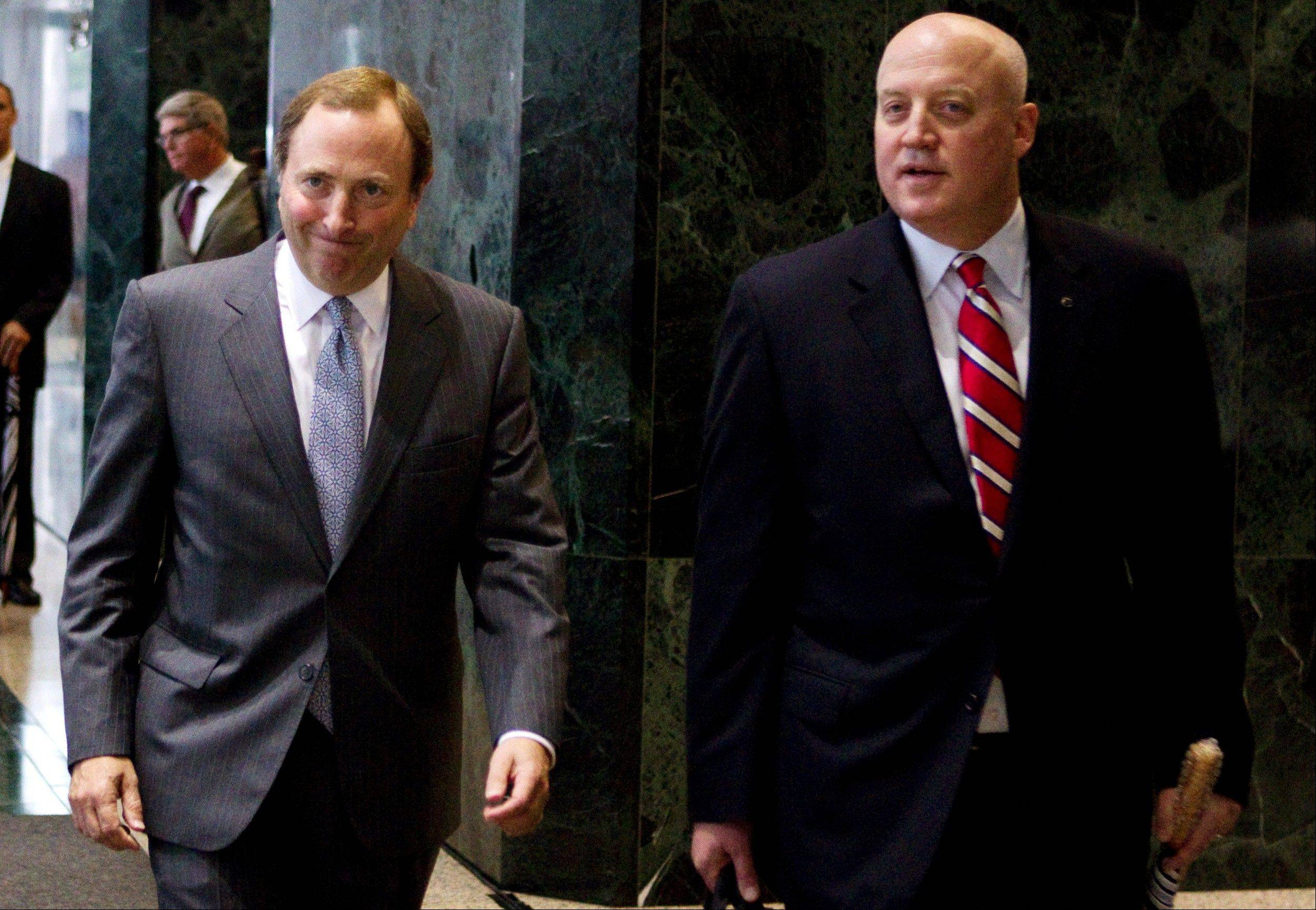 "FILE - This Aug. 14, 2012, file photo shows NHL commissioner Gary Bettman, left, and Bill Daly, deputy commissioner and chief legal officer, following collective bargaining talks in Toronto. The NHL is set to get back to the bargaining table Sunday, Dec. 30, 2012, with the locked-out players� association after a new contract offer from the league broke the ice between the fighting sides. ""We delivered to the union a new, comprehensive proposal for a successor CBA,"" NHL deputy commissioner Bill Daly said in a statement Friday, Dec. 28. ""We are not prepared to discuss the details of our proposal at this time."" (AP Photo/The Canadian Press, Chris Young, File)"