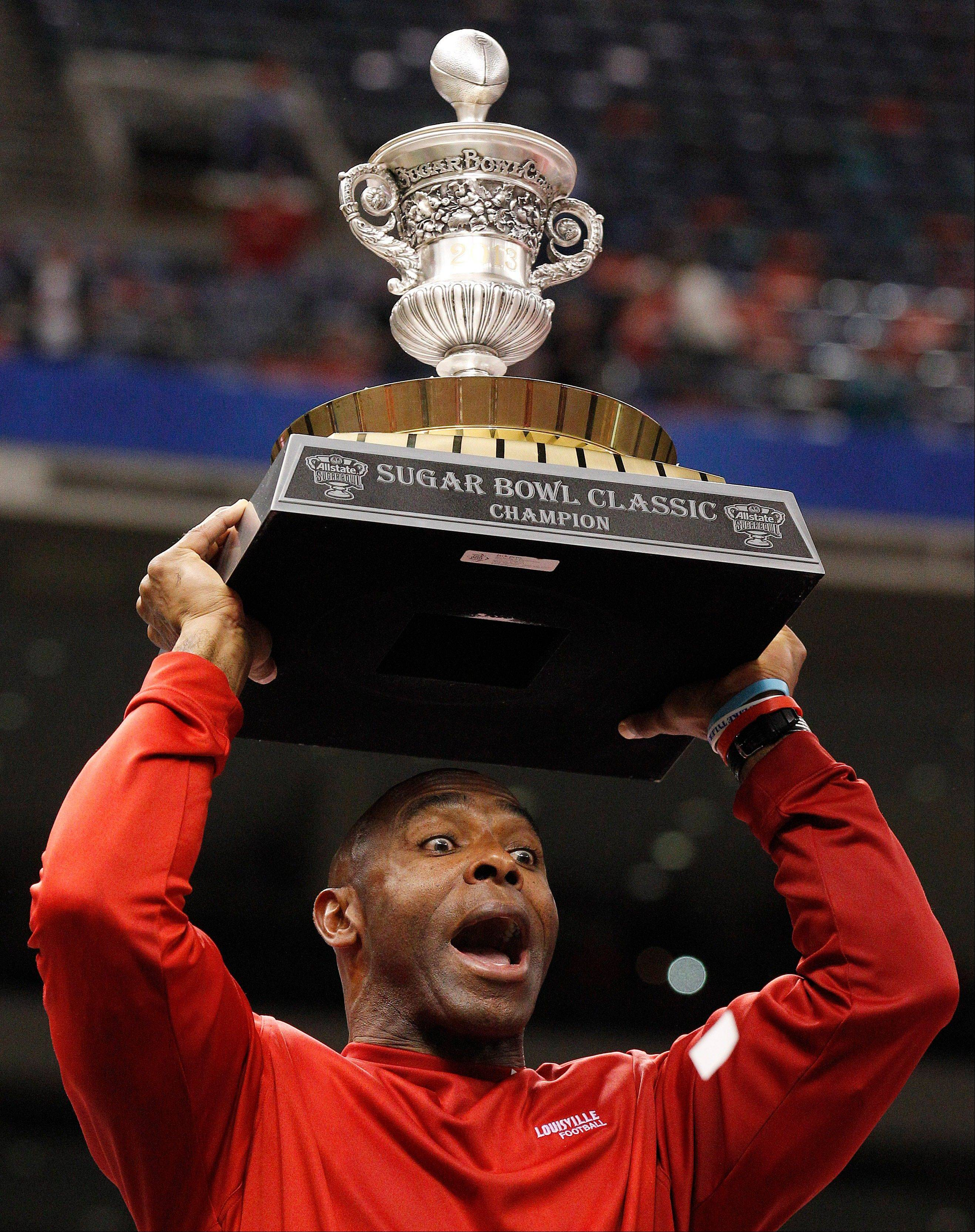 Louisville head coach Charlie Strong of the Big East celebrates following a 33-23 win over No. 3 Florida of the SEC in the Sugar Bowl Wednesday. The SEC is 3-3 in bowl games so far this season.