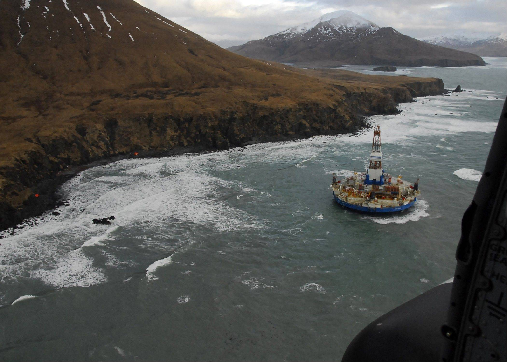Two life rafts sit on the beach adjacent as the conical drilling unit Kulluk sits grounded Thursday 40 miles southwest of Kodiak City. The Kulluk grounded after many efforts by tug vessel crews and Coast Guard crews to move the vessel to safe harbor during a winter storm. Calls for federal scrutiny of Royal Dutch Shell PLC drilling operations in Arctic waters swelled Thursday with a request for a formal investigation by members of Congress.