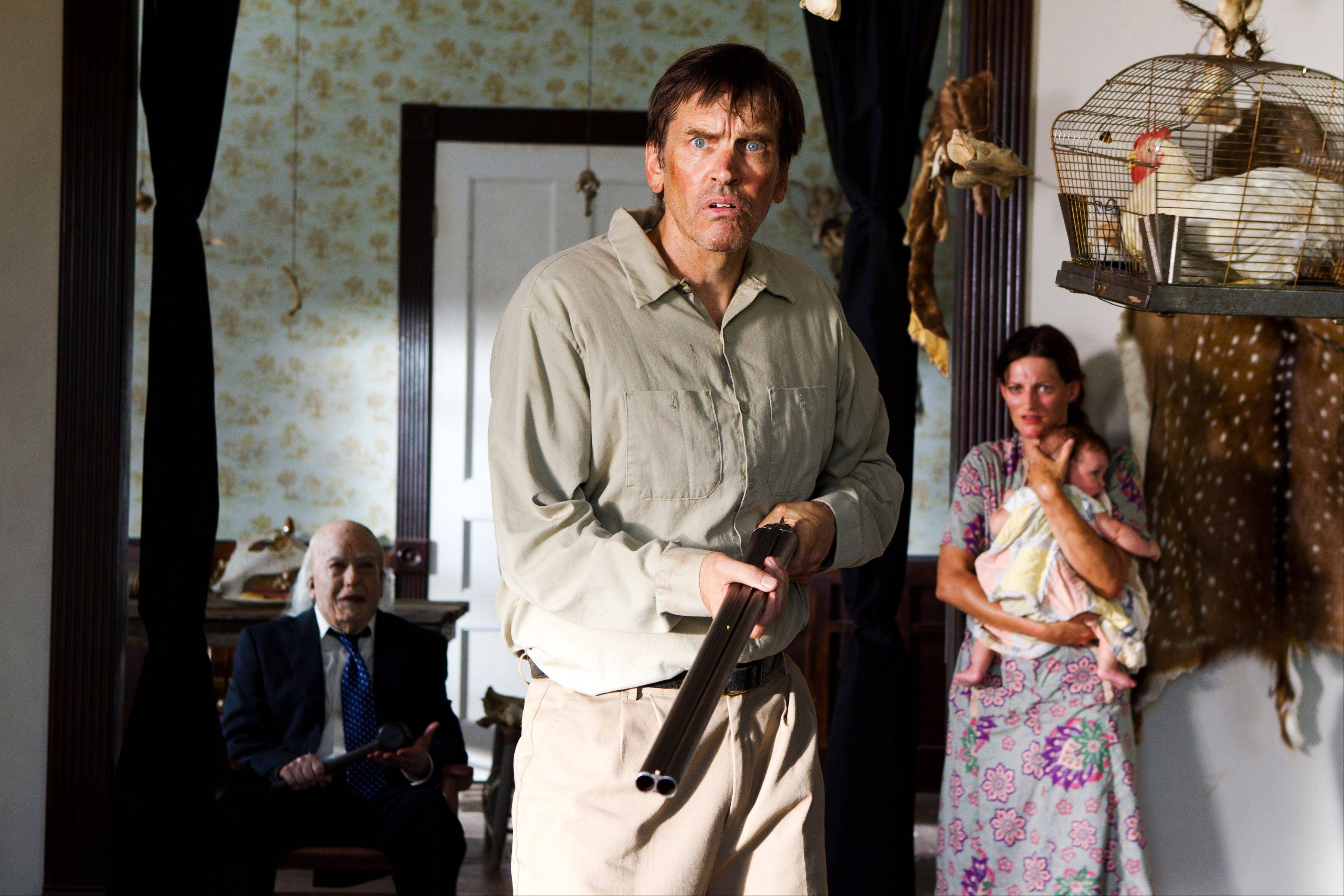 "Grandpa Sawyer (John Dugan), left, and Drayton Sawyer (Bill Moseley) are on guard against danger in ""Texas Chainsaw 3-D."""
