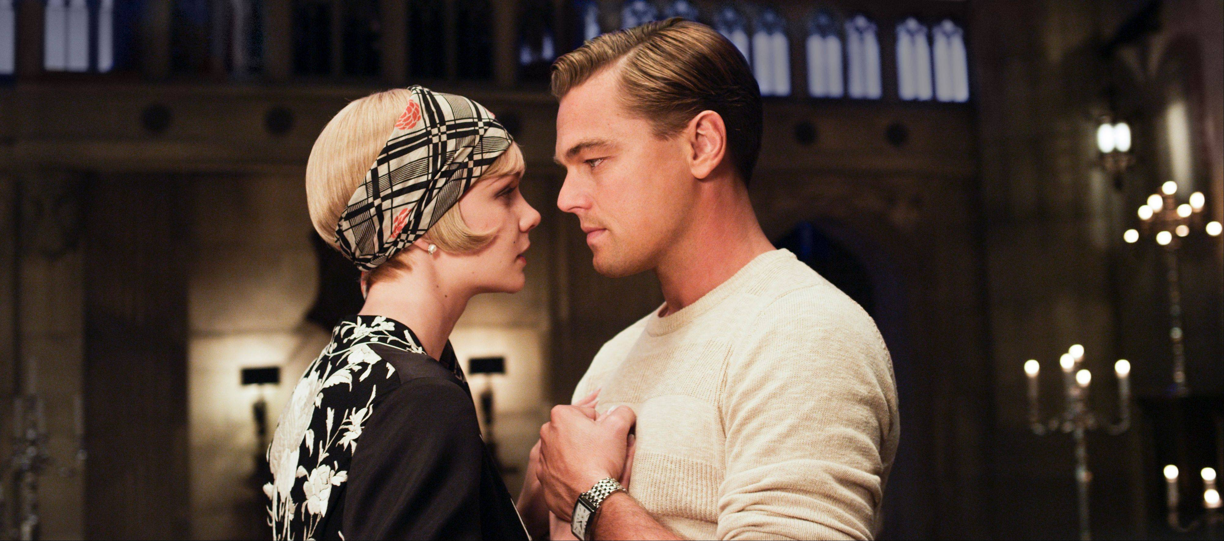"Carey Mulligan stars as Daisy Buchanan and Leonardo DiCaprio as Jay Gatsby in Warner Bros. Pictures' ""The Great Gatsby."""
