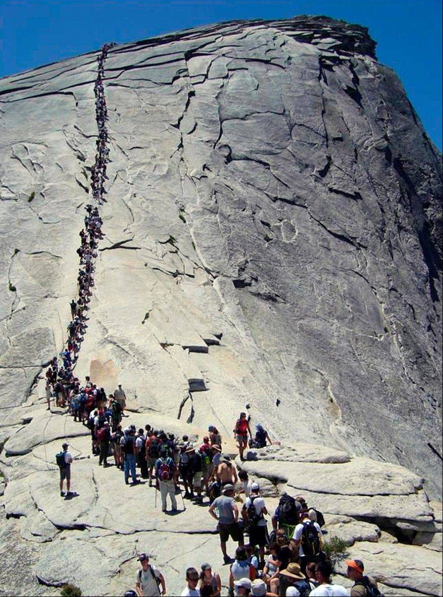 Associated Press/2006 file photoTourists climb Half Dome at Yosemite National Park, Calif.