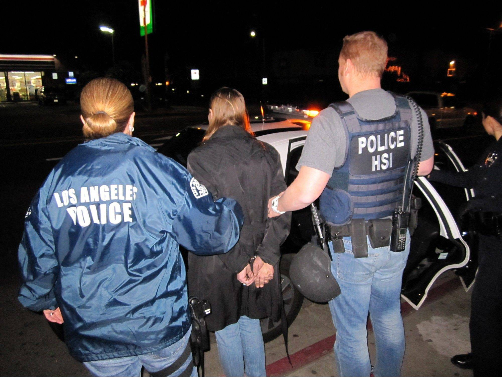 In this image provided by U.S. Immigration and Customs Enforcement (ICE), Letha Mae Montemayor, is arrested Thursday on suspicion of child pornography charges.