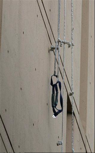 A harness and the end of a rope dangle from a window on the back side of the Metropolitan Correctional Center on Dec. 18. Two convicted bank robbers used a knotted rope made of bed sheets to escape from the federal prison window high above downtown Chicago.
