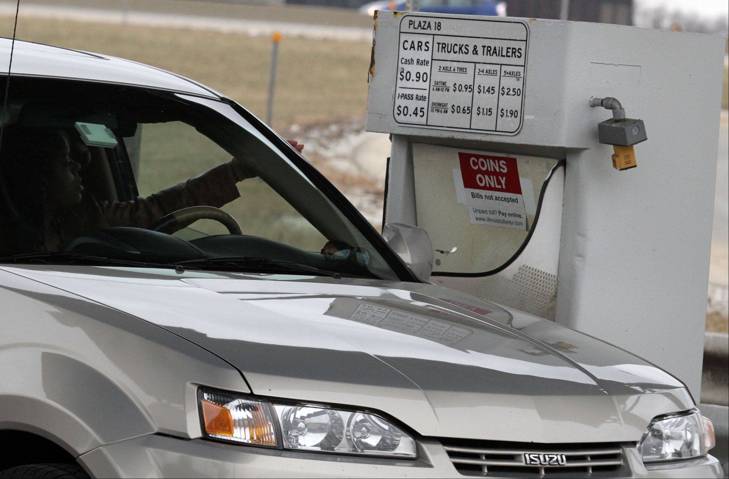 A driver pays up at the Arlington Heights Road entrance to the Jane Addams Tollway.