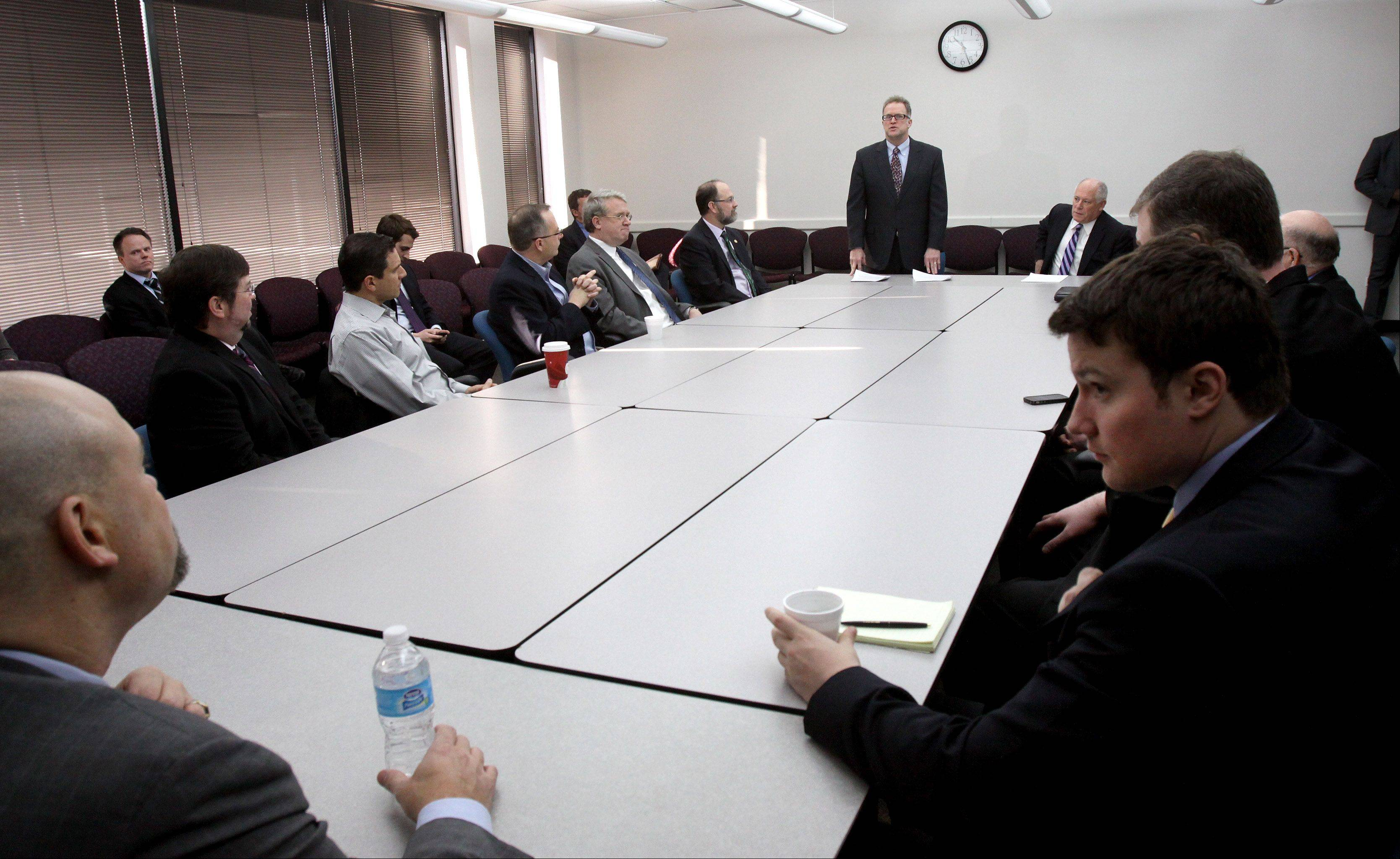 Gov. Pat Quinn and DuPage County Board Chairman Dan Cronin meet with other lawmakers Friday in Wheaton to discuss pension reform.