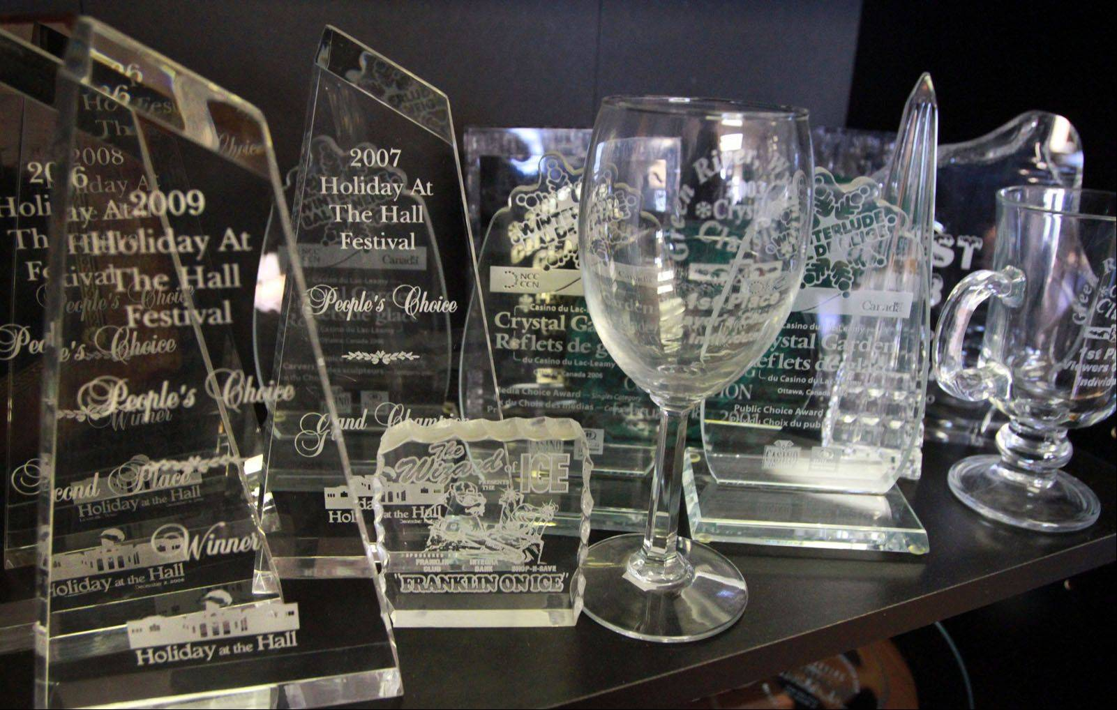 Dan Rebholz's studio office shelves and walls are filled with trophies and awards he has won. He is ranked sixth in the U.S. by the National Ice Carving Association.