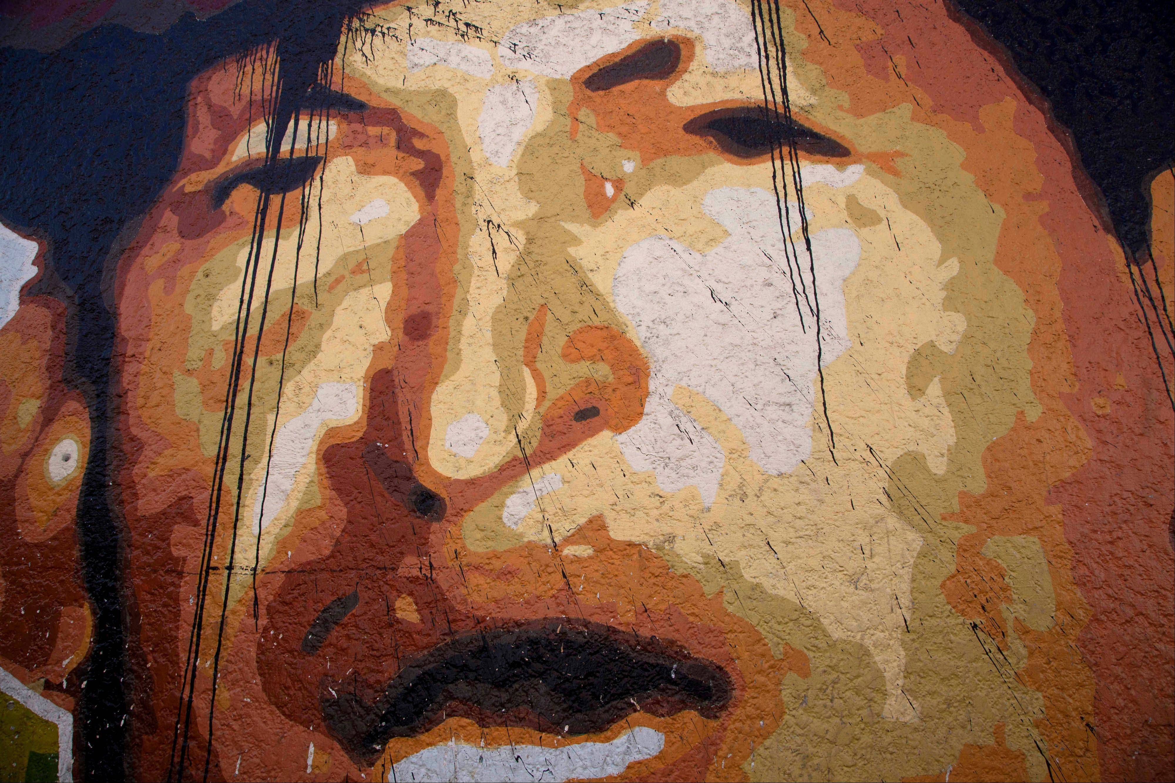 "A mural depicting Venezuela's President Hugo Chavez in Caracas, Venezuela, Thursday, Jan. 3, 2013. Venezuelan President Hugo Chavez is being treated for ""respiratory deficiency"" after complications from a severe lung infection, his government said, pointing to a deepening crisis for the ailing 58-year-old president."