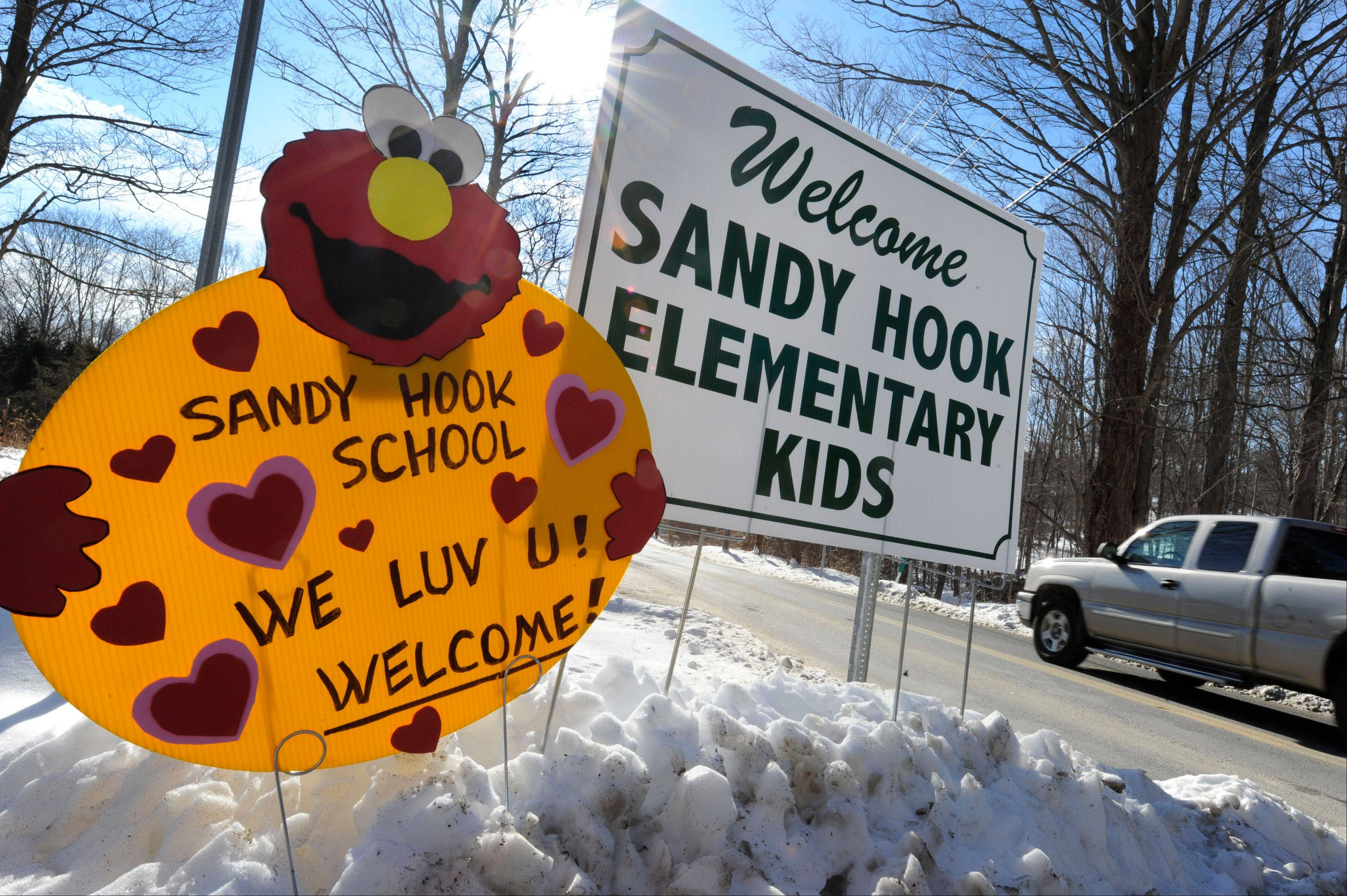A sign Thursday welcomes Sandy Hook Elementary school children on their first day of classes near the former Chalk School in Monroe, Conn.