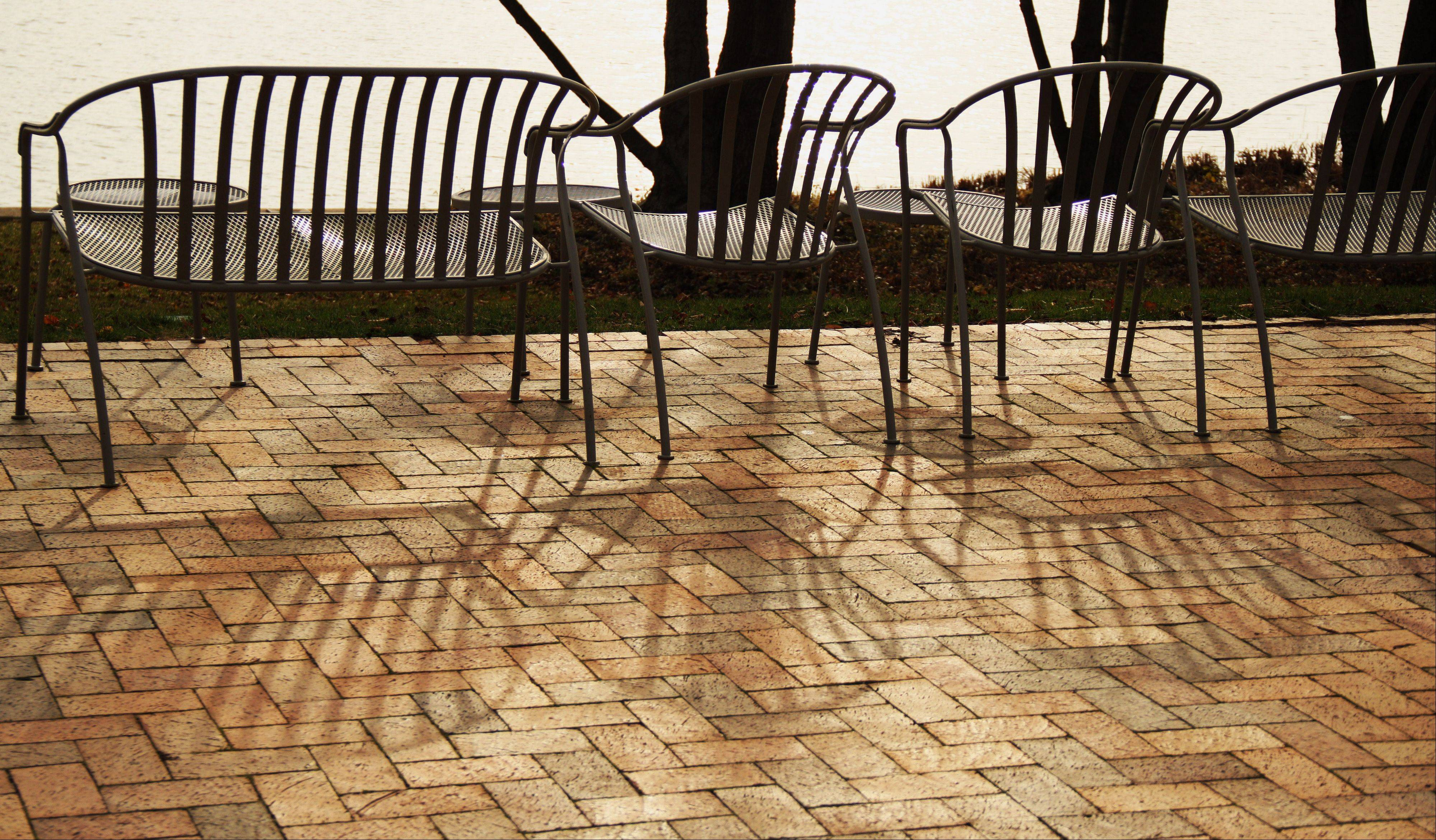 Th shadows from the chairs contrasts with the pattern of the bricks on a mild December day at the Chicago Botanic Garden.
