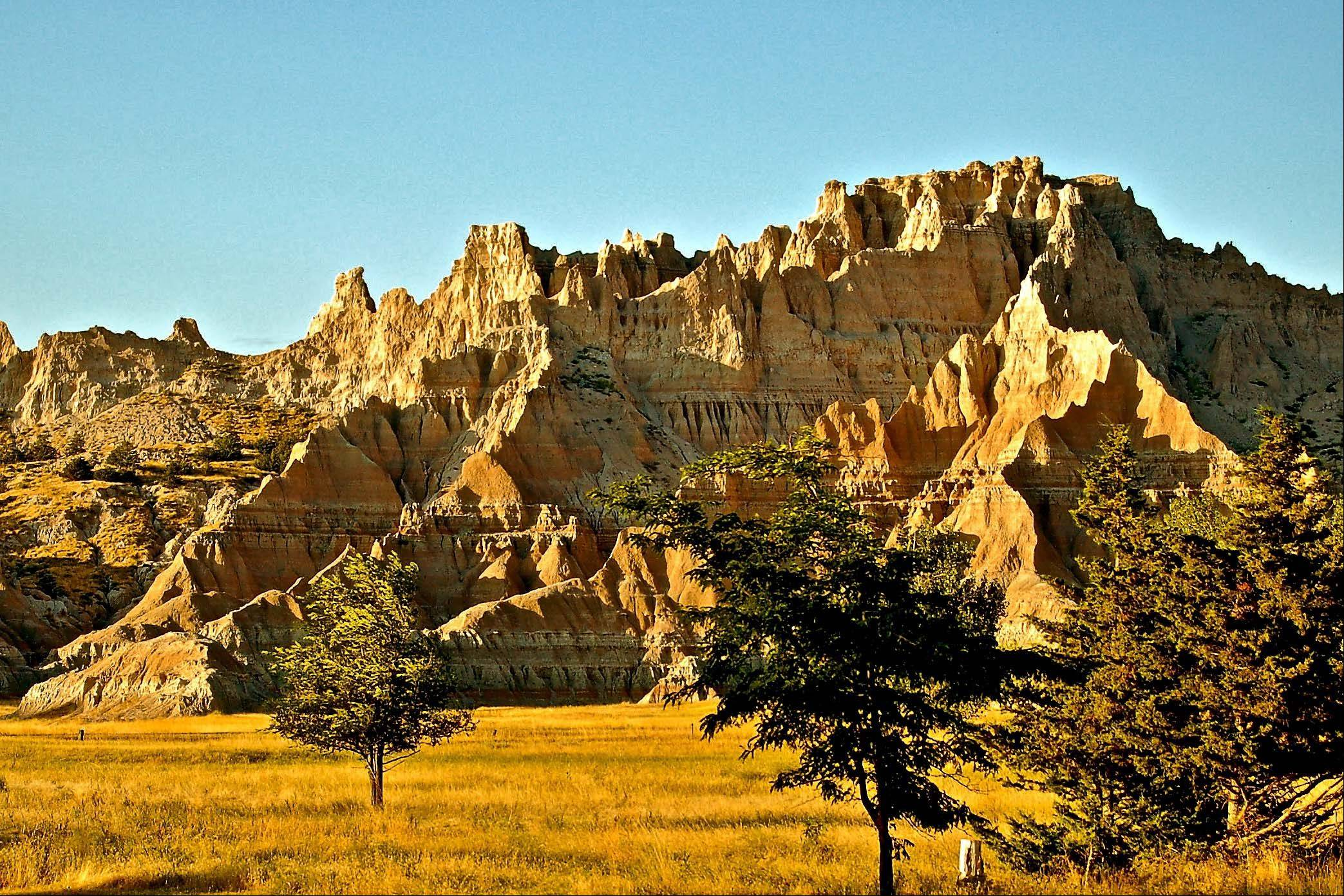 This picture was taken in Badlands National Park, South Dakota while walking a trail one early evening this past September. The stratified colors are beautiful in the evening especially if the ground is damp from a recent rain.