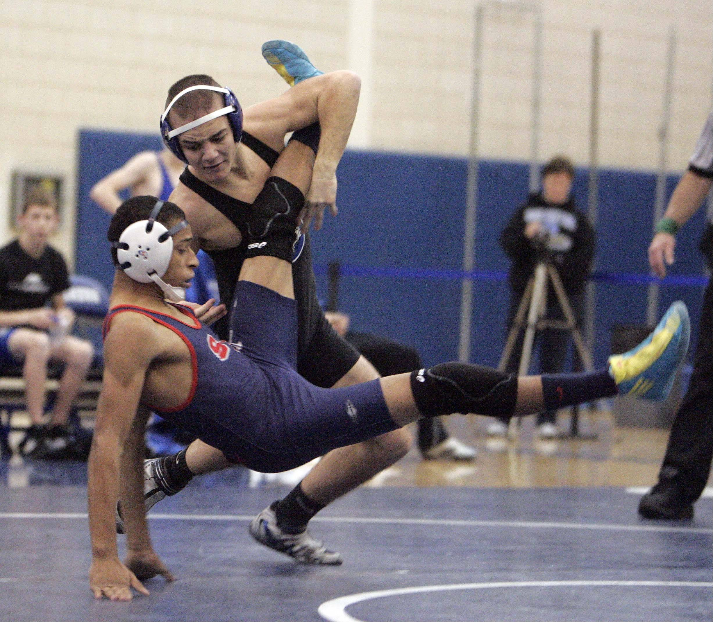 Geneva's Brad Martens defeated South Elgin's Mike Perez at 120 pounds Friday in Geneva.