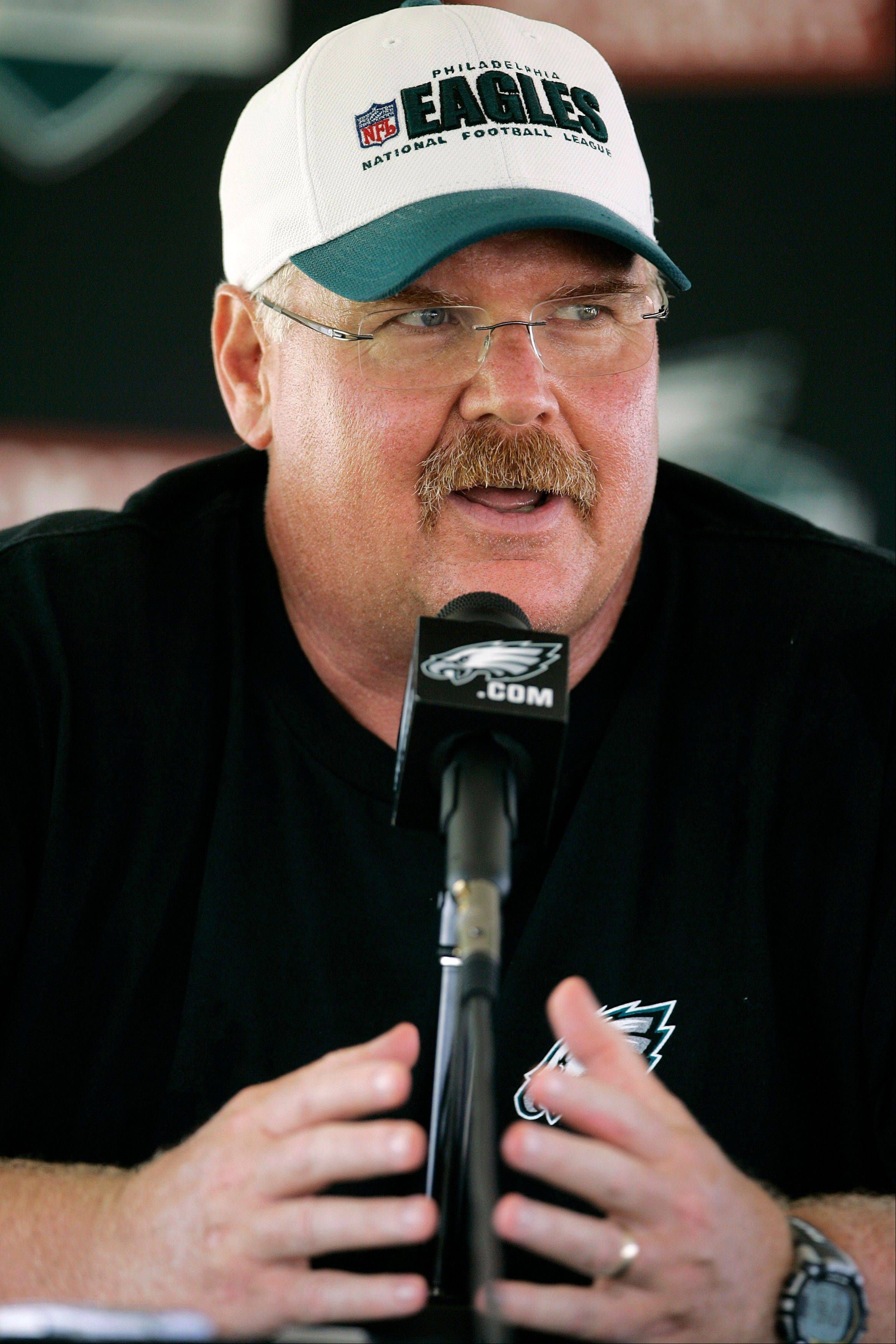 FILE - This July 30, 2011 file photo shows Philadelphia Eagles head coach Andy Reid talking with the media after the morning session at NFL football training camp at Lehigh University in Bethlehem, Pa. Reid arrived in Kansas City on Friday, Jan. 4, 2012, and the Chiefs are close to making an official announcement that he will become their next coach.