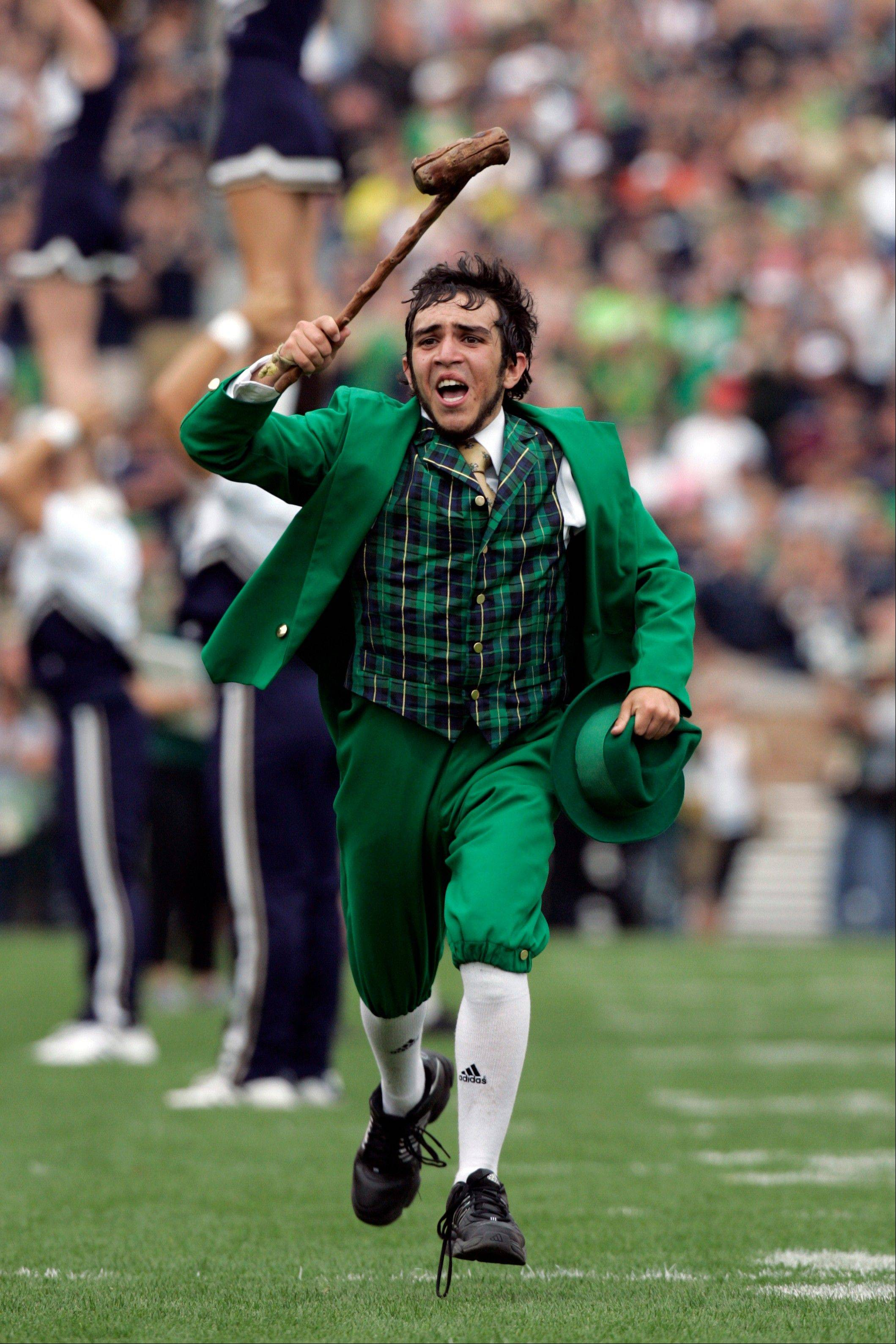 The Notre Dame leprechaun mascot takes the field.