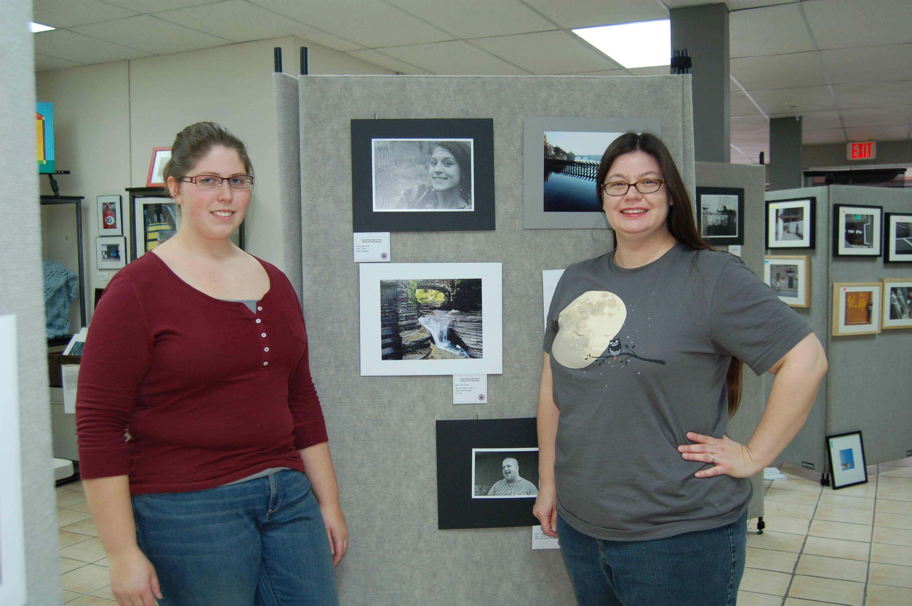 "High school senior and Gallery 200 member Alyse Teschke (left) and South Elgin High School teacher Barbara Bernard (right) take a break from installing the ""South Elgin Advanced Photography Exhibit"" which will be on display through January 27,  2013 at Gallery 200 in West Chicago, Illinois."