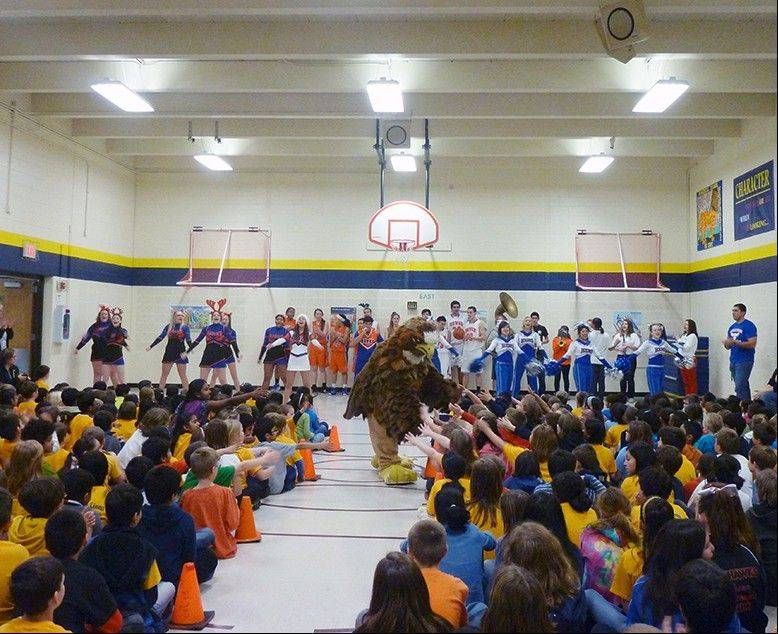 Students in Schaumburg Township Elementary District 54 were happy to see the Hoffman Estates High School hawk mascot.