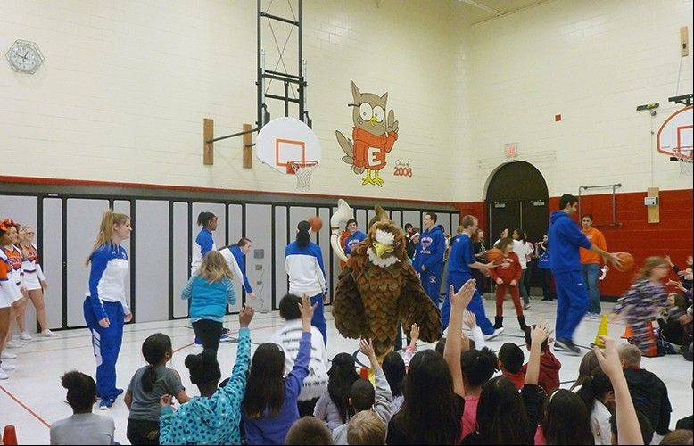 Students at Albert Einstein Elementary School shoot hoops with the girls and boys varsity basketball teams.