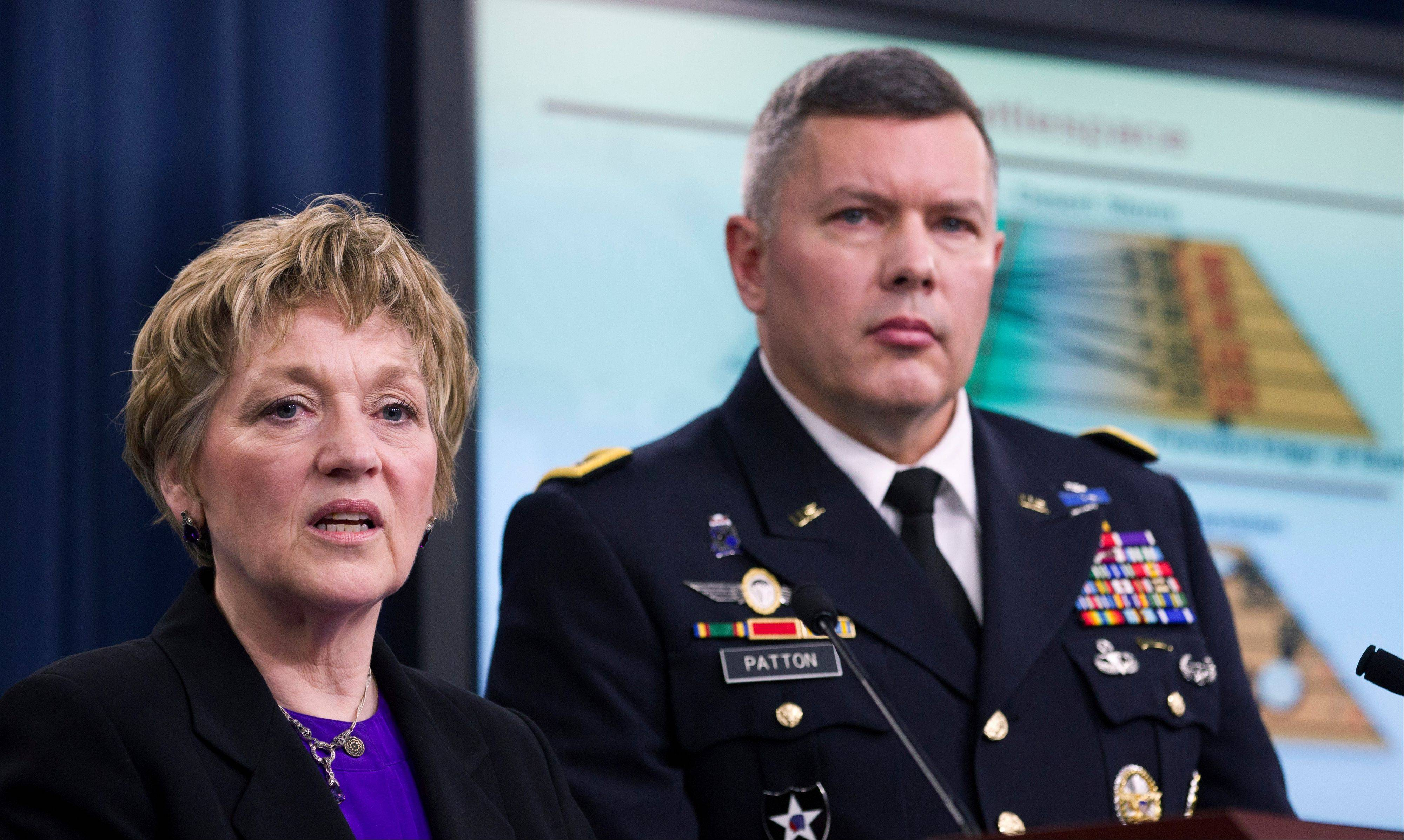 Deputy Defense Undersecretary for Military Personnel Policy Vee Penrod, left, and Principal Director for Military Personnel Policy Maj. Gen. Gary Patton, speak at the Pentagon on the results of the department�s Women in Service Review.
