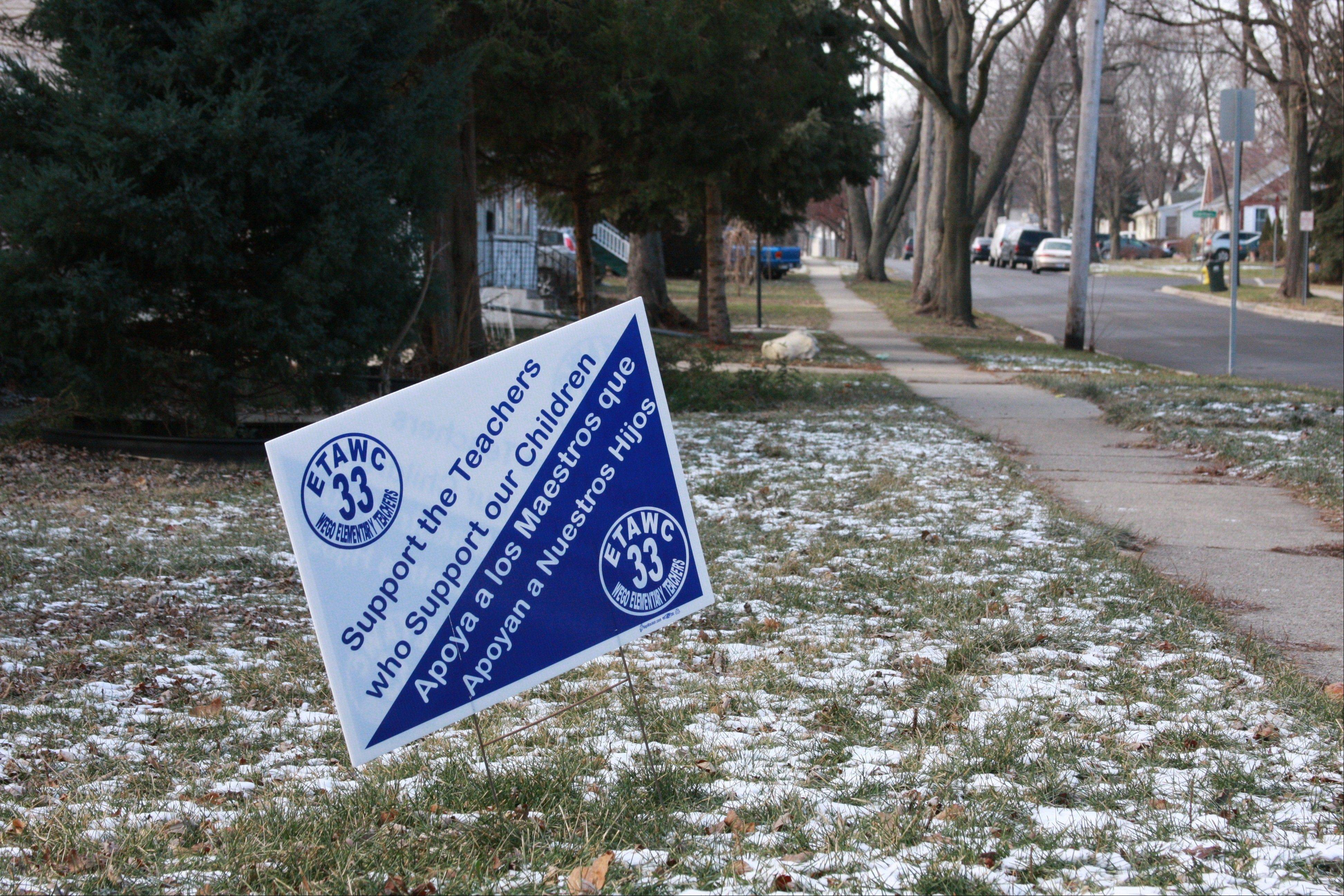 Signs in some West Chicago lawns support the teachers union, which will meet again Wednesday with the District 33 school board for a negotiating session in an attempt to avoid a strike.