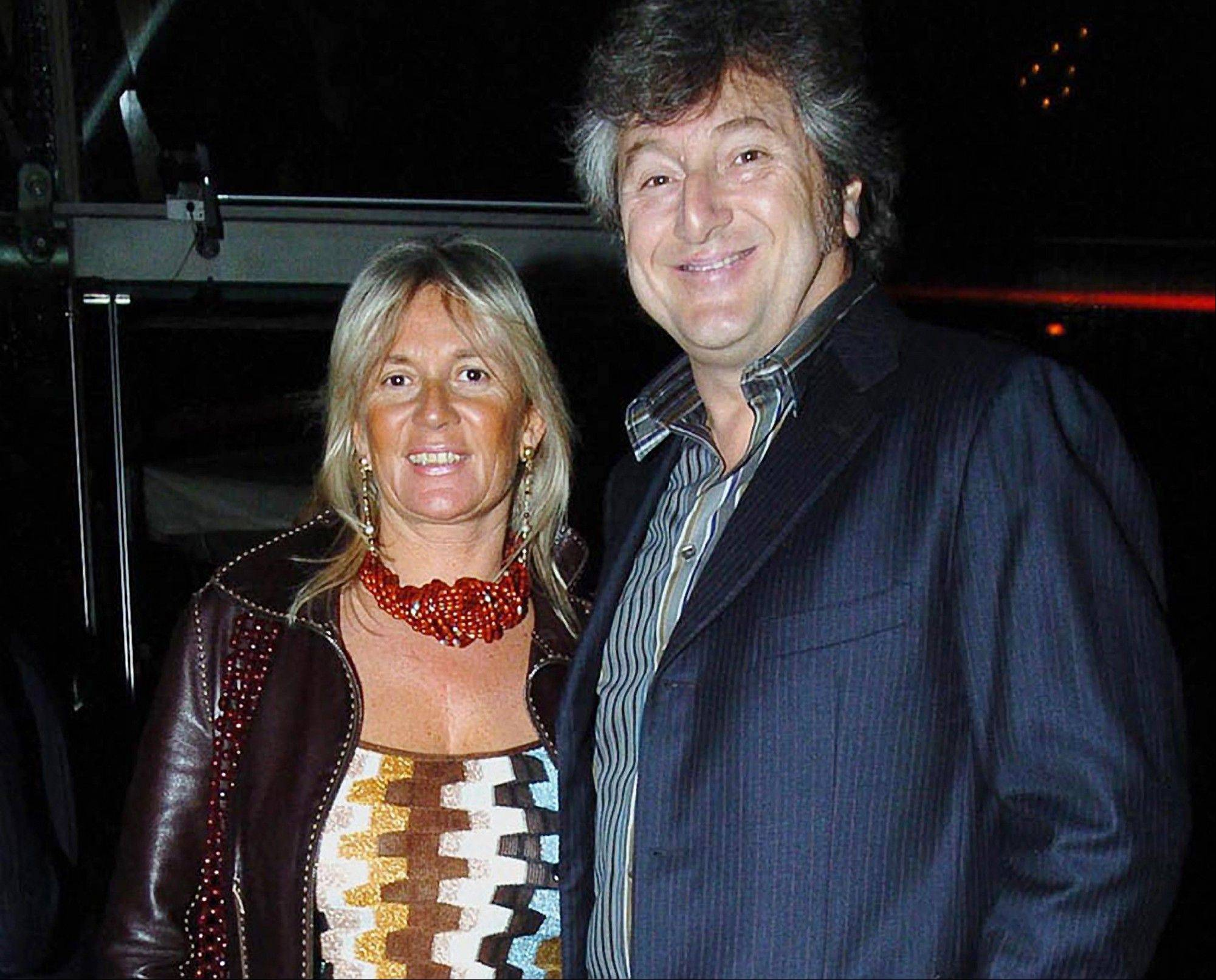 Vittorio Missoni, right, and his wife Maurizia Castiglioni smile in Milan, Italy.