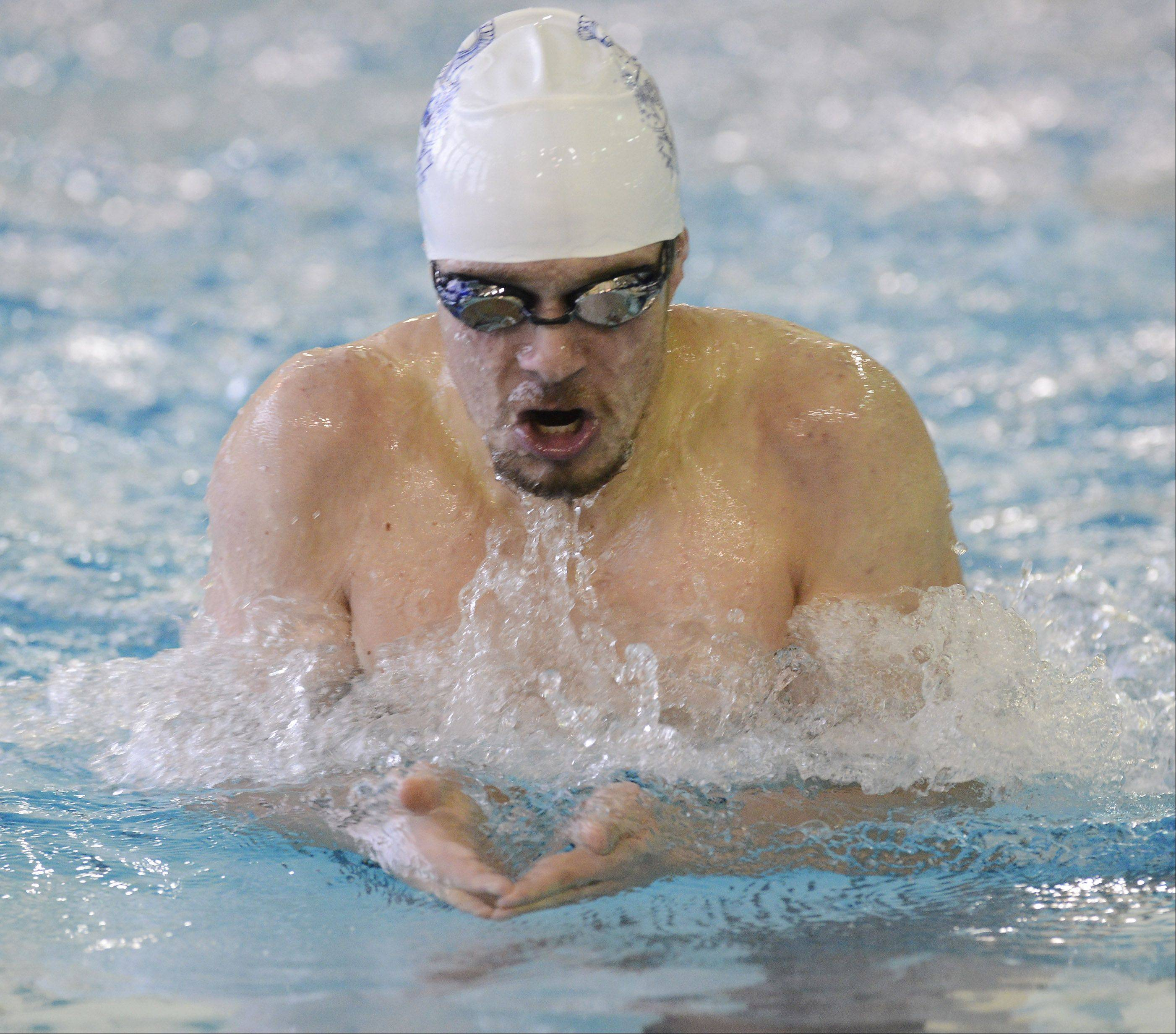 Michael Hamann of Cary-Grove competes in the 200-yard individual medley during Elk Grove's invitational on Saturday.