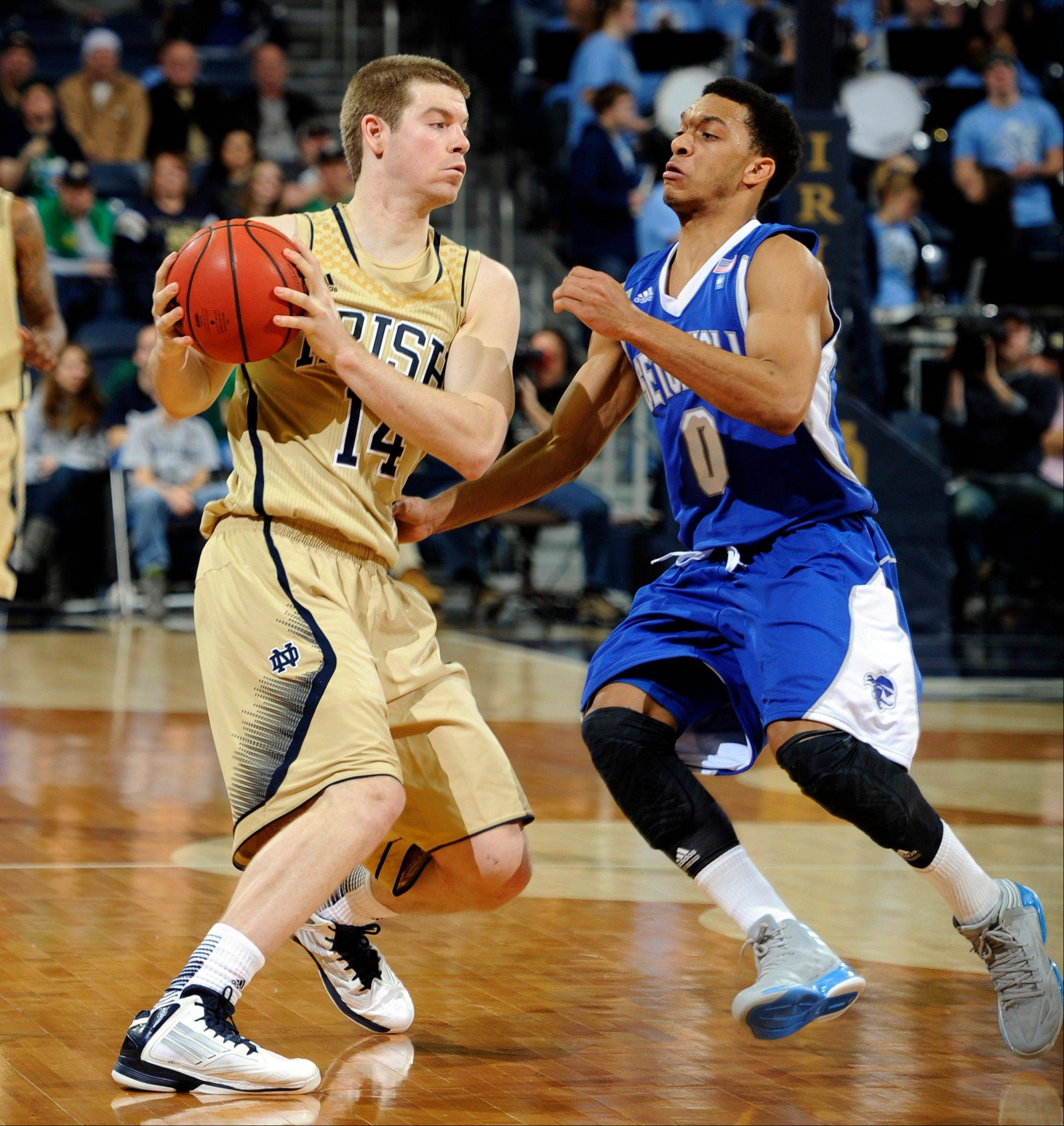 Notre Dame guard Scott Martin, left, gets ready to shoot as Seton Hall guard Tom Maayan defends the second half of an NCAA college basketball game wth Notre Dame Saturday, Jan. 5, 2013, in South Bend, Ind. Notre Dame won 93-74 with Martin leading all scorers with 22 points. (AP Photo/Joe Raymond)