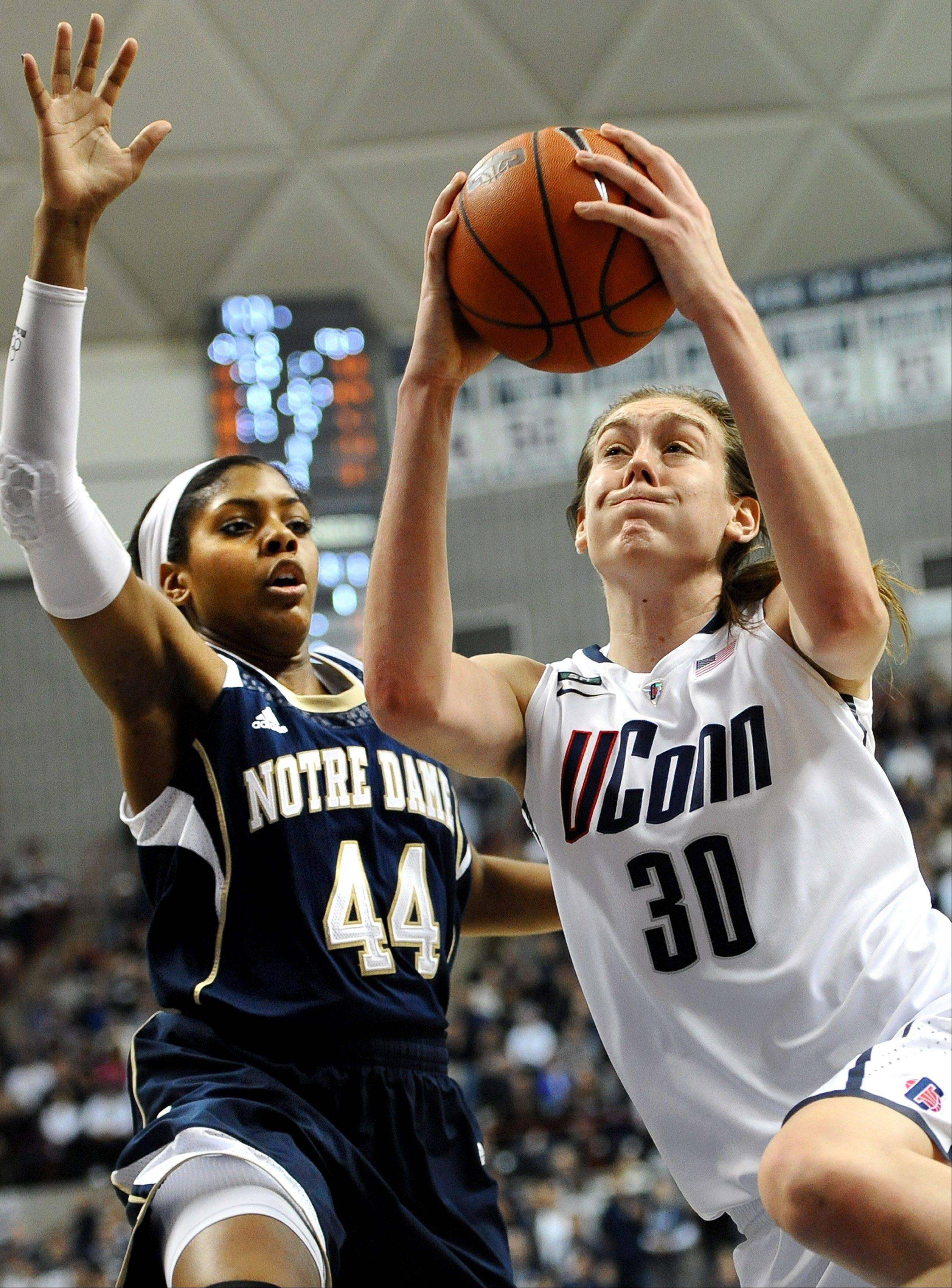 Connecticut's Breanna Stewart (30) drives to the basket while guarded by Notre Dame's Ariel Braker during the second half of an NCAA college basketball game in Storrs, Conn., Saturday, Jan. 5, 2013. Notre Dame won 73-72. (AP Photo/Jessica Hill)