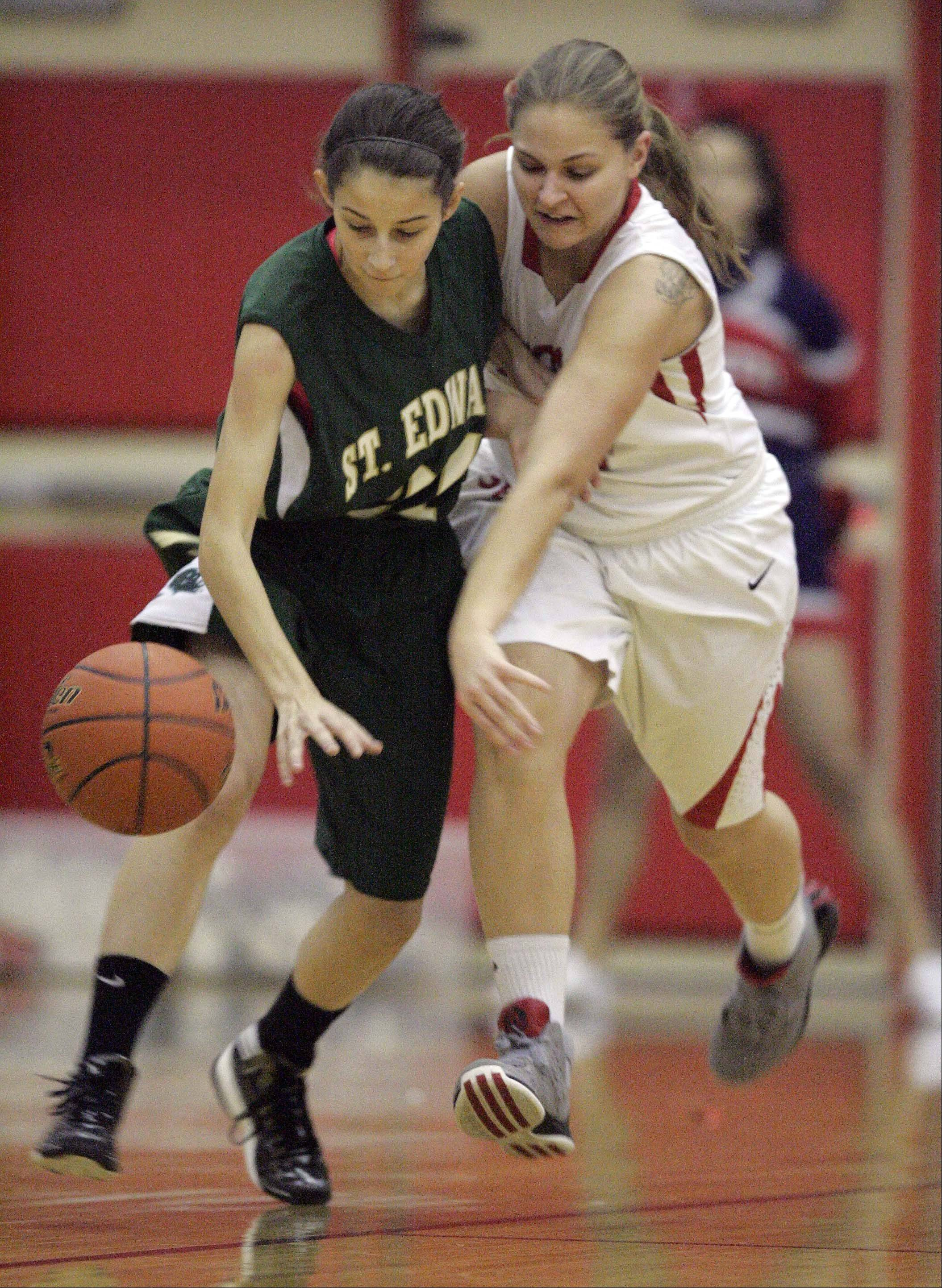 St. Edward�s Chelsea Gnan, 31, puts the pressure on 34 South Elgin�s Amanda Behles, 34, during girls basketball Saturday January 5, 2013