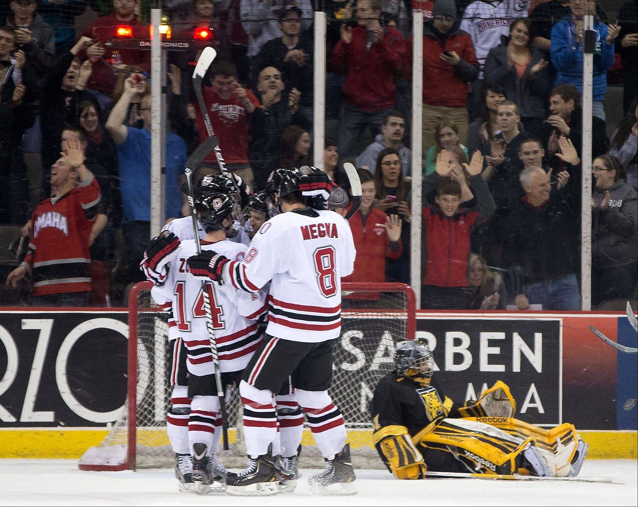 Nebraska-Omaha's Jaycob Megna (8), Dominic Zombo (14) and teammates celebrate in the third period with Josh Archibald after he scored his third goal of the night against Colorado College in a hockey game Friday, Jan. 4, 2013, in Omaha, Neb. Nebraska-Omaha won 8-4. (AP Photo/The Omaha World-Herald, Mark Davis) MAGS OUT LOCAL TV OUT