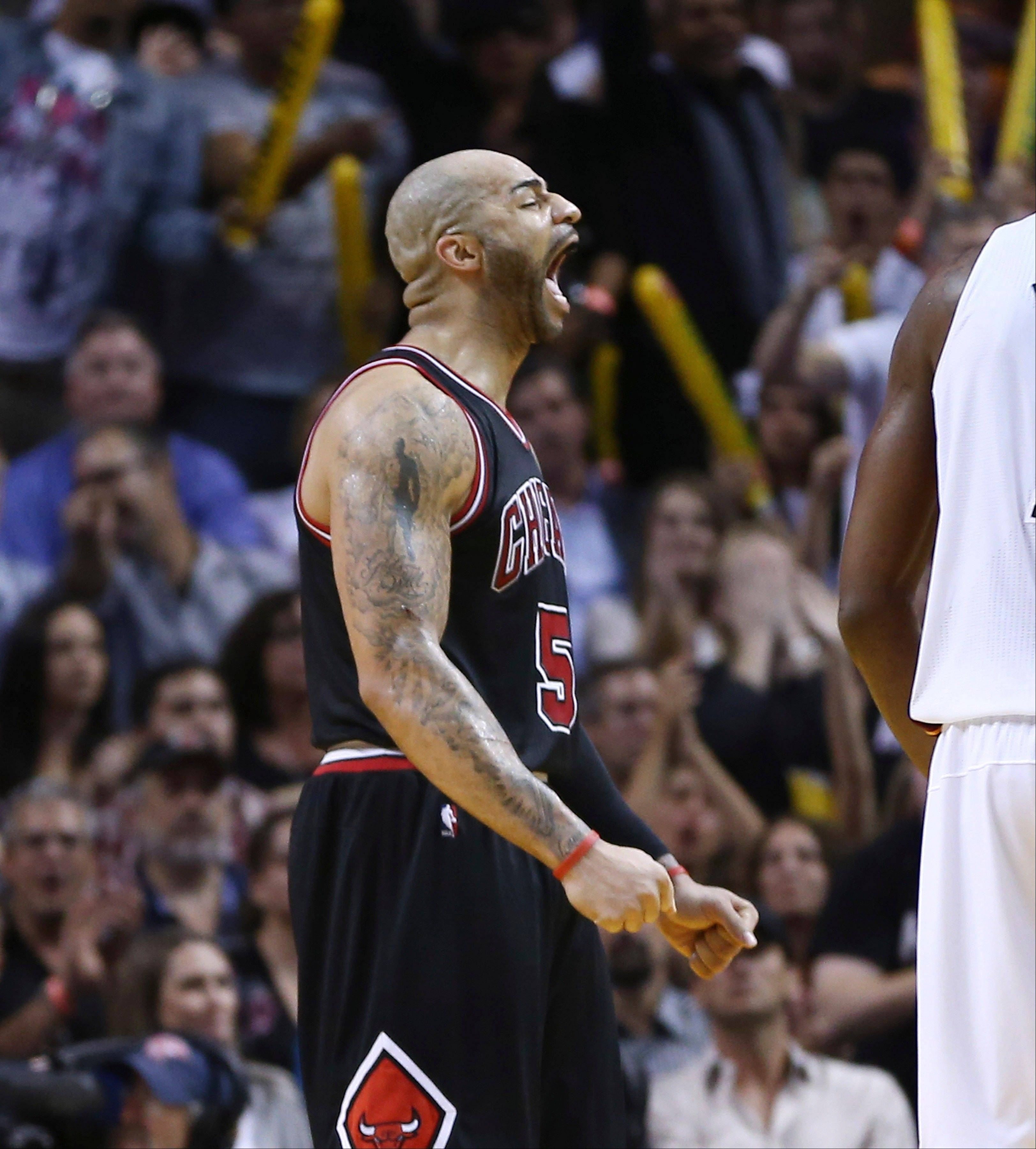 Chicago Bulls player Carlos Boozer reacts after the Miami Heat were charged with an offensive foul during the second half of an NBA basketball game in Miami, Friday, Jan. 4, 2013. The Bulls won 96-89. (AP Photo/J Pat Carter)